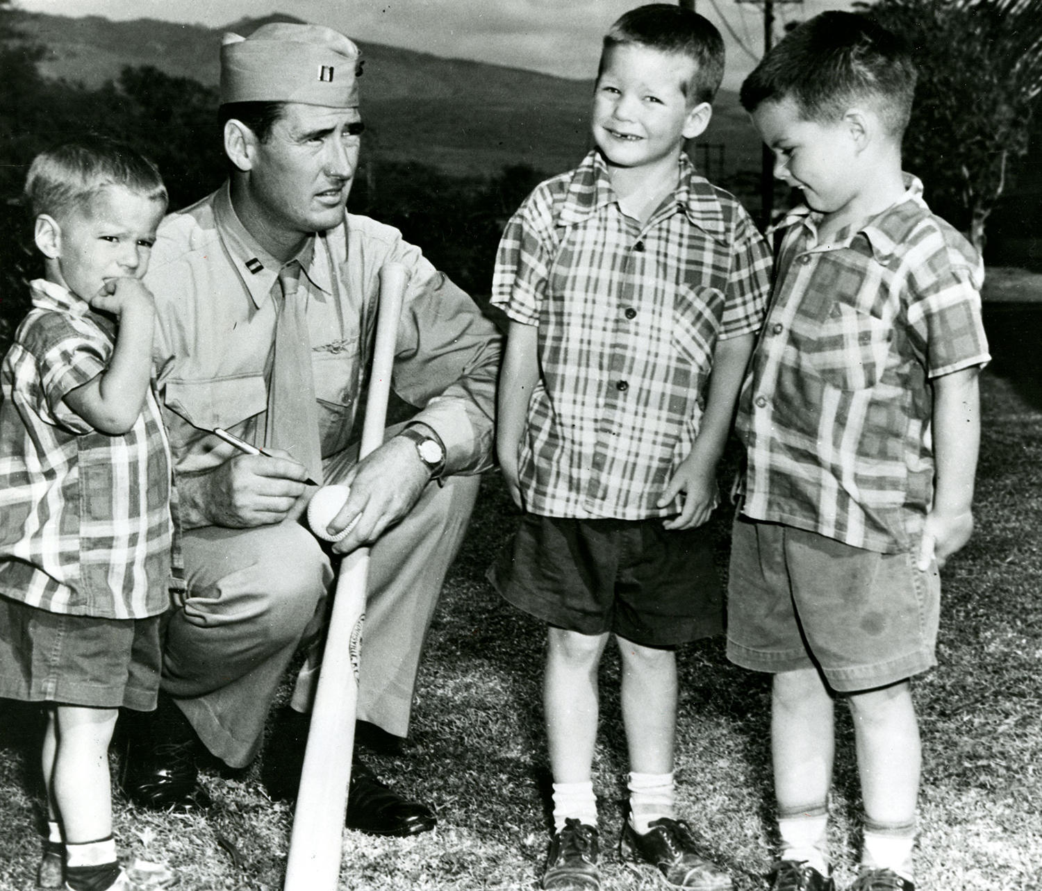 """Ted Williams signs autographs for some young fans while in Honolulu in 1953, en route to Korea. <a href=""""http://collection.baseballhall.org/islandora/object/islandora%3A501812"""">PASTIME</a> (National Baseball Hall of Fame)"""