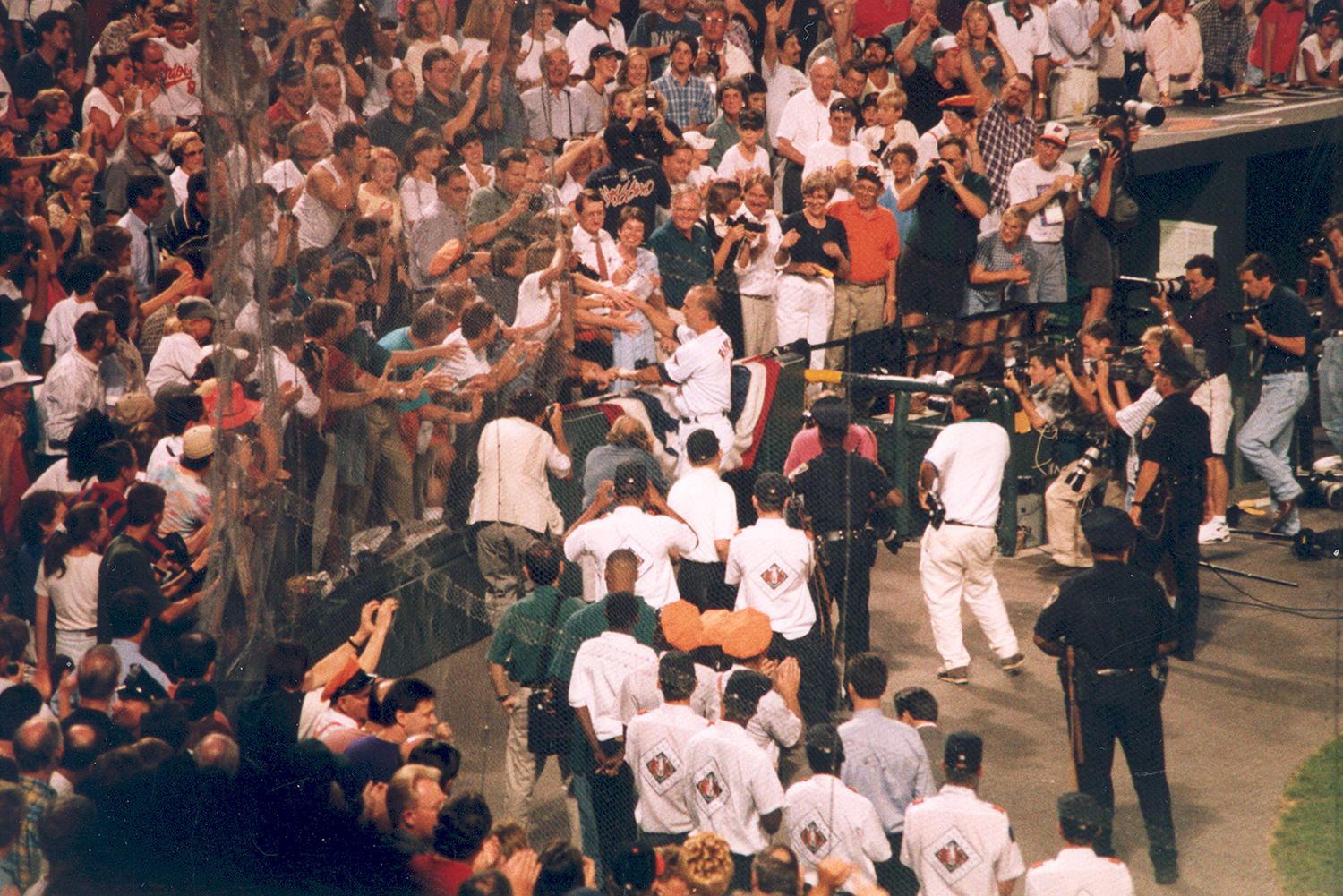Cal Ripken takes a lap after the fifth inning of his 2,131st consecutive game played on Sept. 6, 1995. (National Baseball Hall of Fame and Museum)