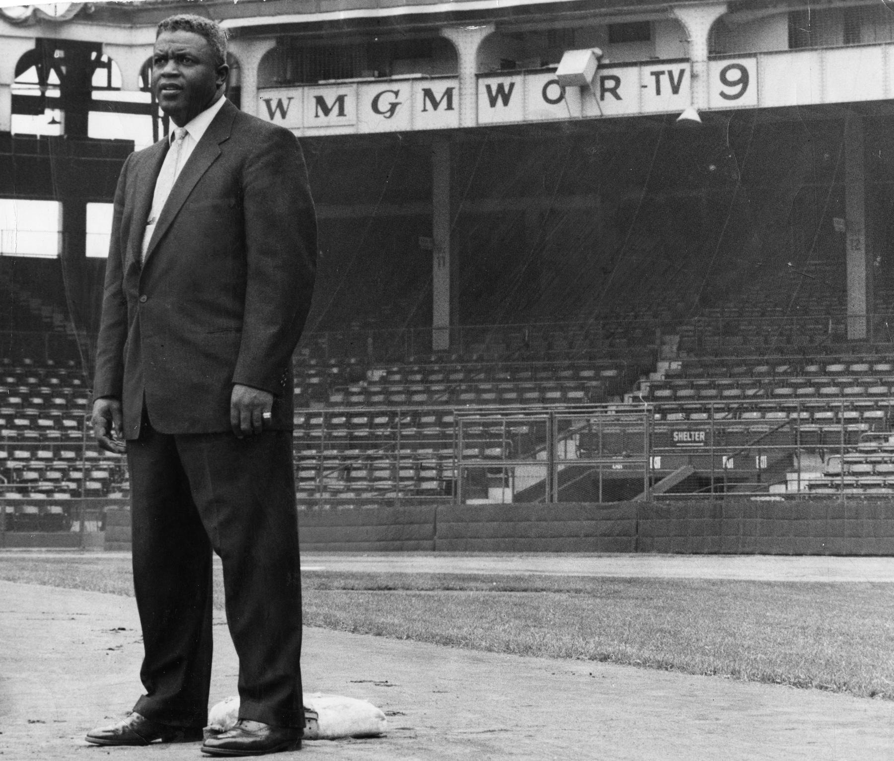 Jackie Robinson on the field at Ebbets the night before the home opener the year after his reitement, 1957. BL-1529-68WTqq (National Baseball Hall of Fame Library)