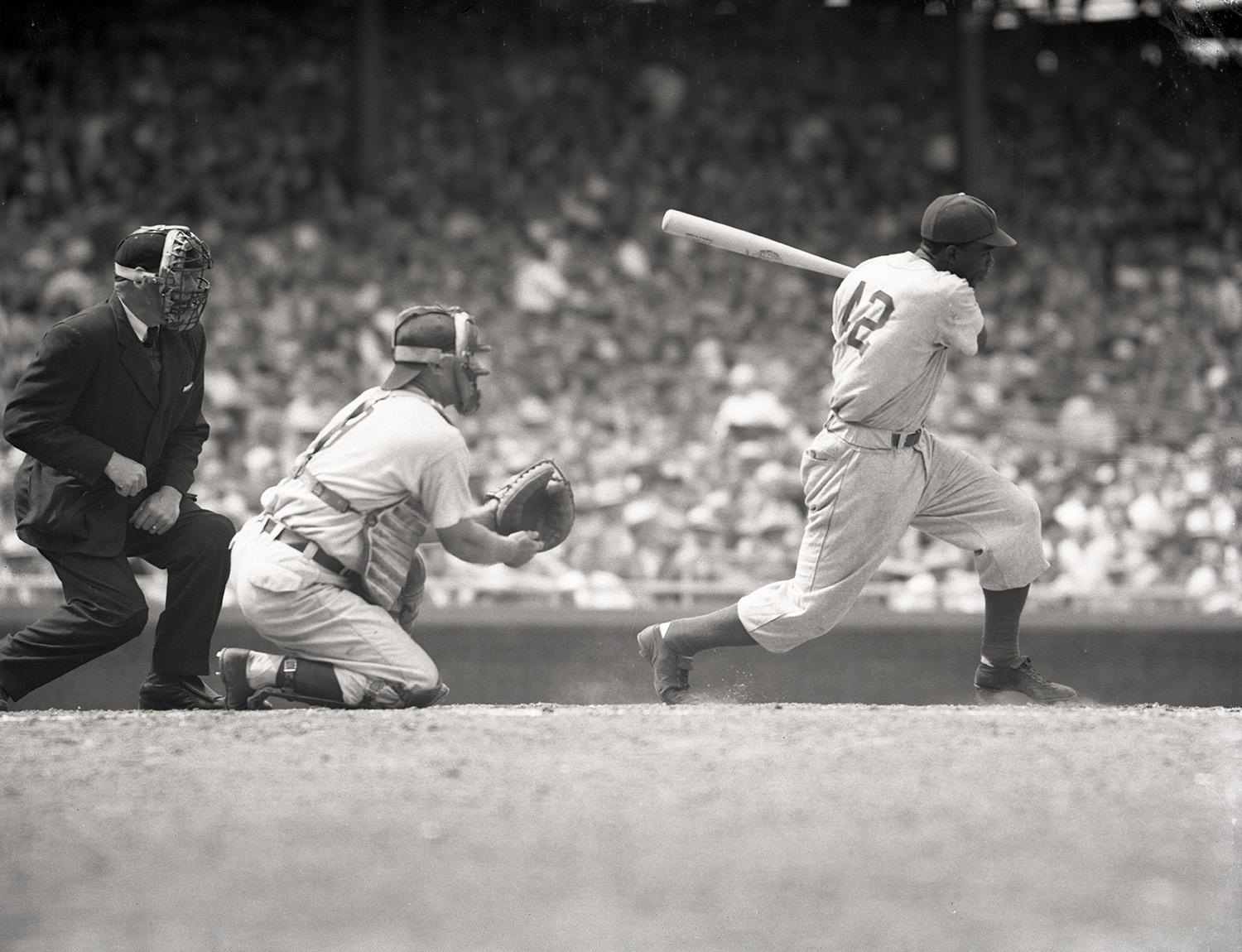 """Jackie Robinson, pictured above,  inspired Emmett Ashford to pursue umpiring after Robinson broke baseball's color barrier in 1947. <a href=""""http://collection.baseballhall.org/islandora/object/islandora%3A323858"""">PASTIME</a> (National Baseball Hall of Fame and Museum)"""