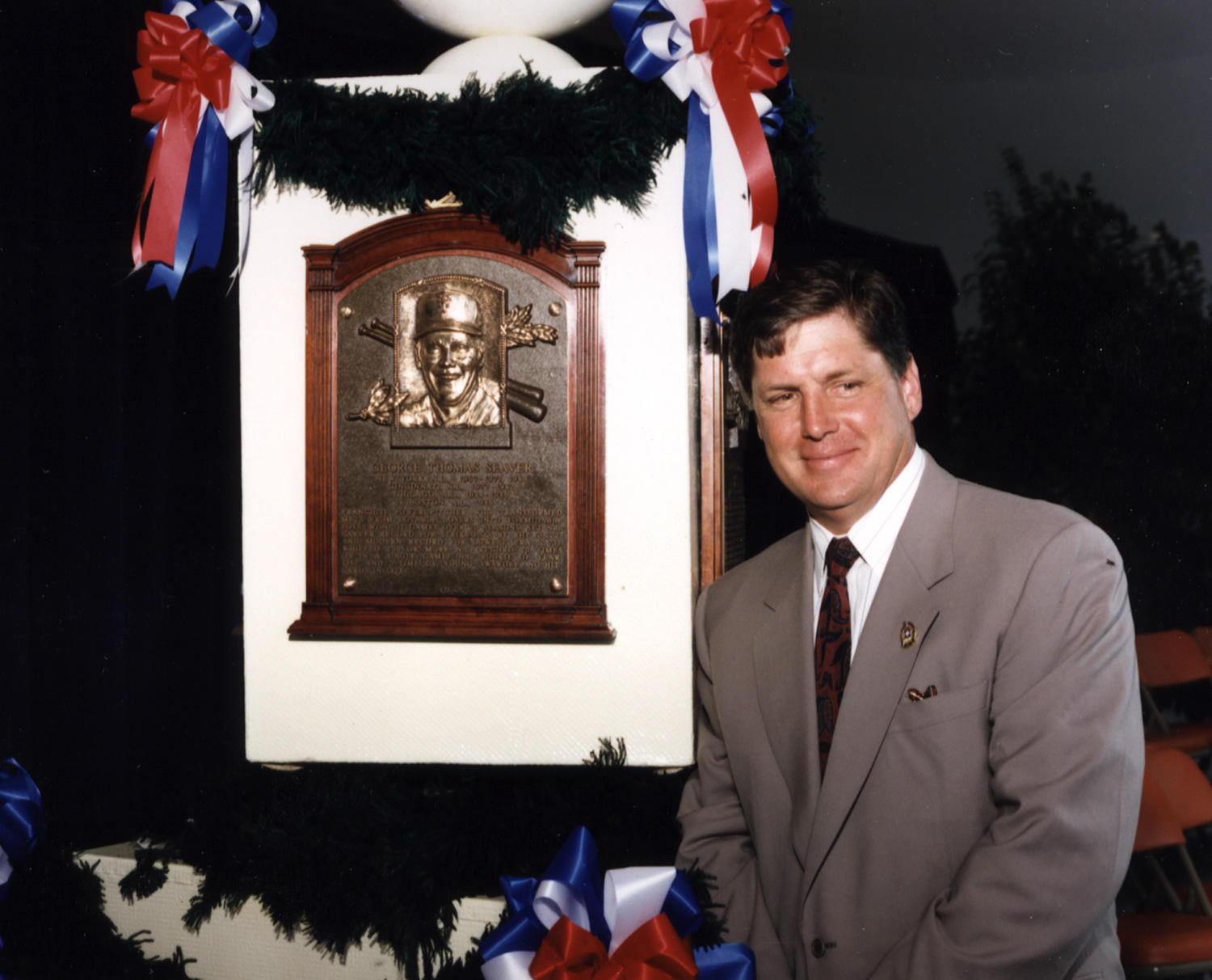 Tom Seaver next to his plaque, during the 1992 National Baseball Hall of Fame Induction Ceremony. He would receive a record-breaking 98.84 percent of the BBWAA vote. (National Baseball Hall of Fame)