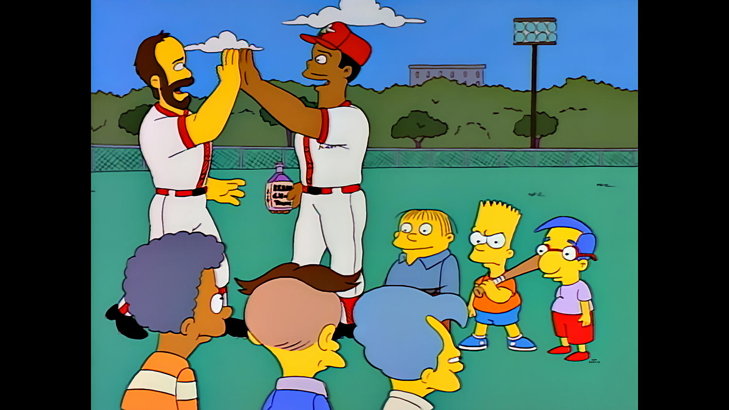 "Hall of Famers Wade Boggs (left) and Ken Griffey Jr. were among the baseball players featured in THE SIMPSONS ""Homer at the Bat"" episode. Boggs will participate in THE SIMPSONS roundtable discussion at this year's Hall of Fame Classic. (Photo Courtesy of FOX)"