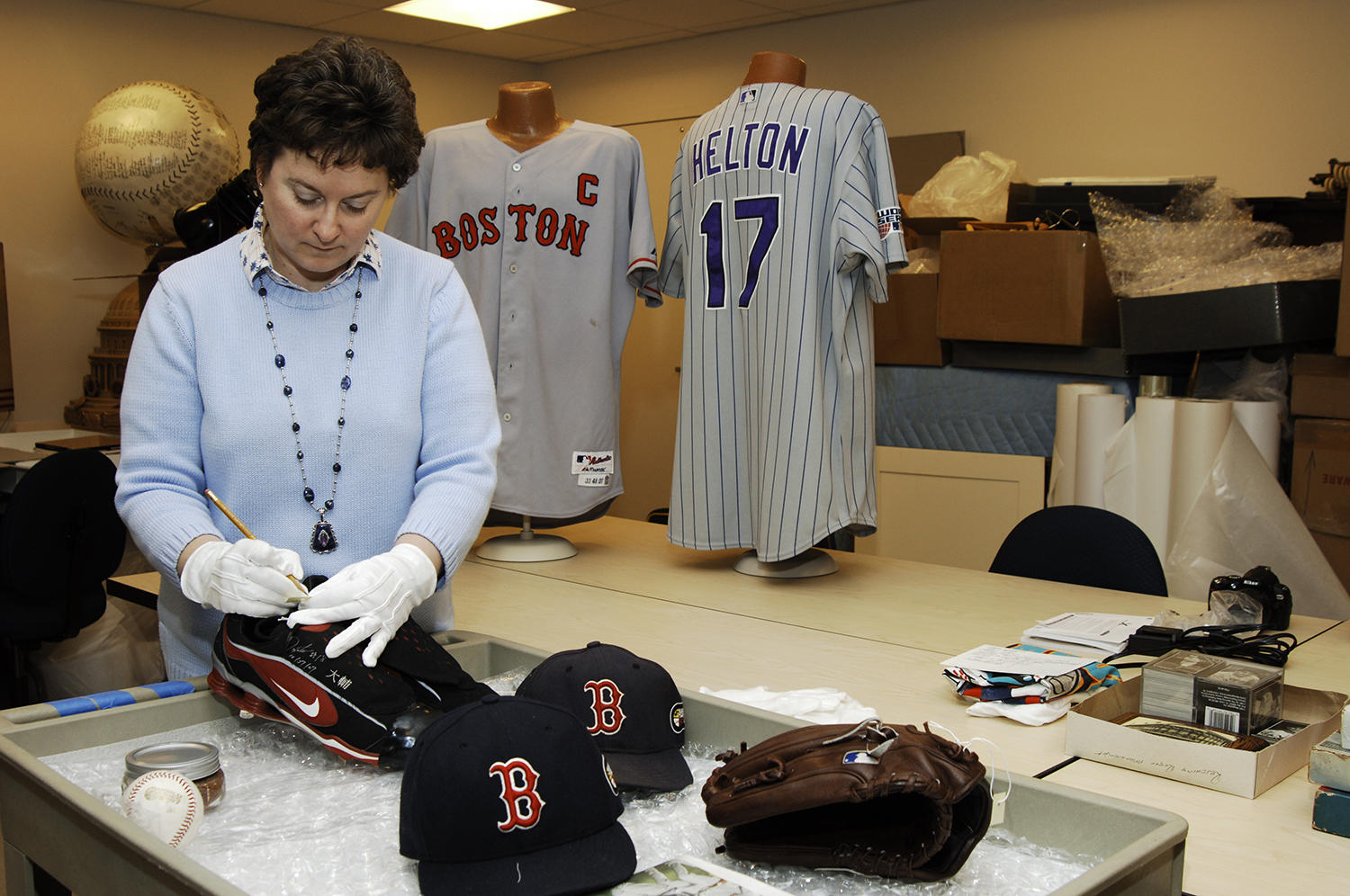 Hall of Fame director of collections Sue MacKay accessions artifacts prior to storing them in collections. (Milo Stewart Jr./National Baseball Hall of Fame and Museum)