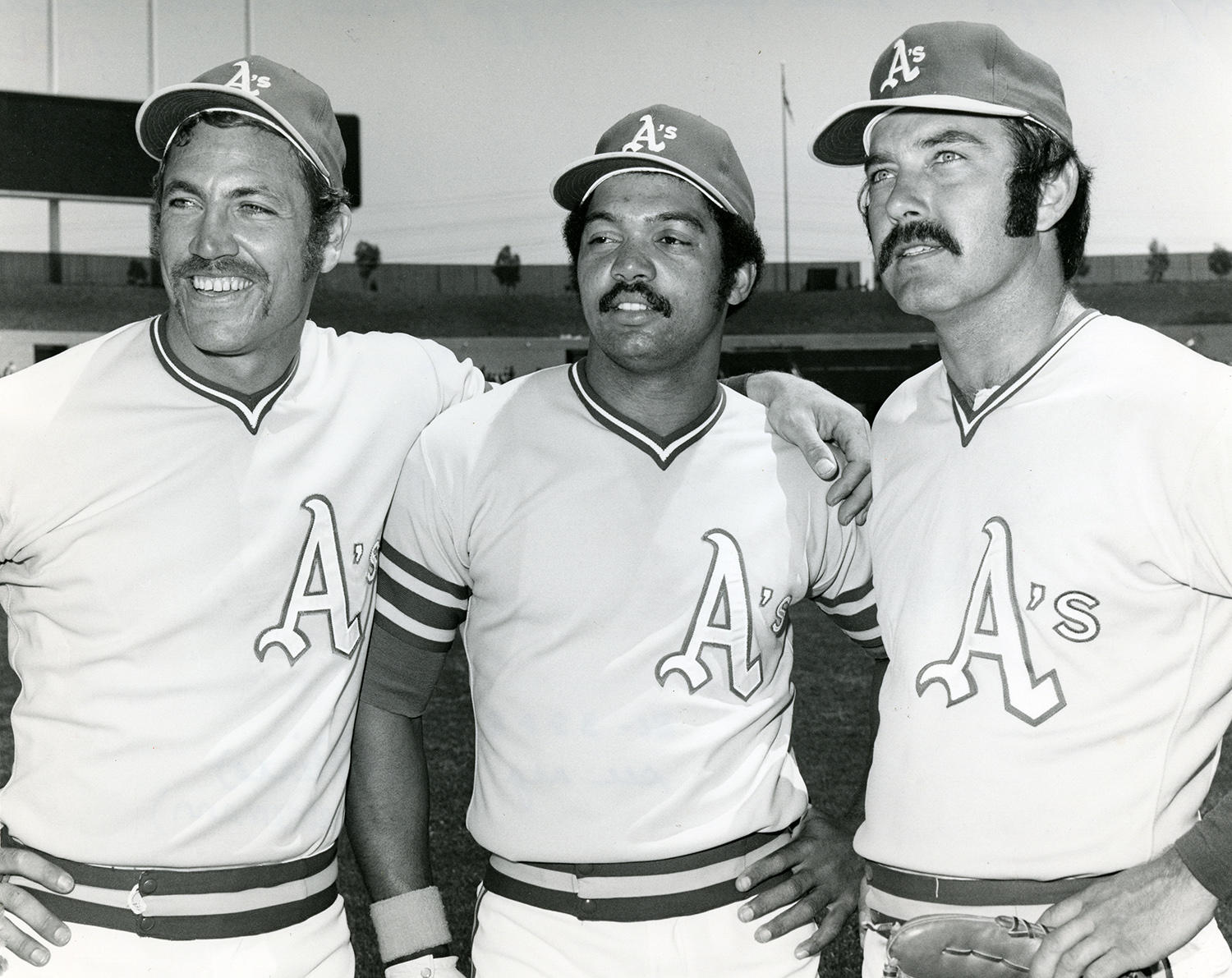 Reggie Jackson (center) pictured with two members of the 1972 Oakland Athletics: Mike Epstein (left) and Darold Knowles (right).  (National Baseball Hall of Fame and Museum)