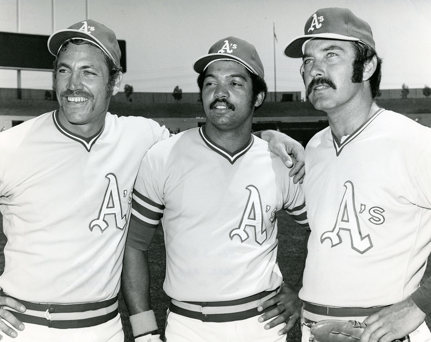 """The 1972 Oakland A's were known throughout baseball as the """"Mustache Gang"""" after the team started sporting facial hair once Reggie Jackson (center) showed up to Spring Training with a mustache. Pictured to the left of Jackson is Mike Epstein and on the right is Darold Knowles. (National Baseball Hall of Fame and Museum)"""