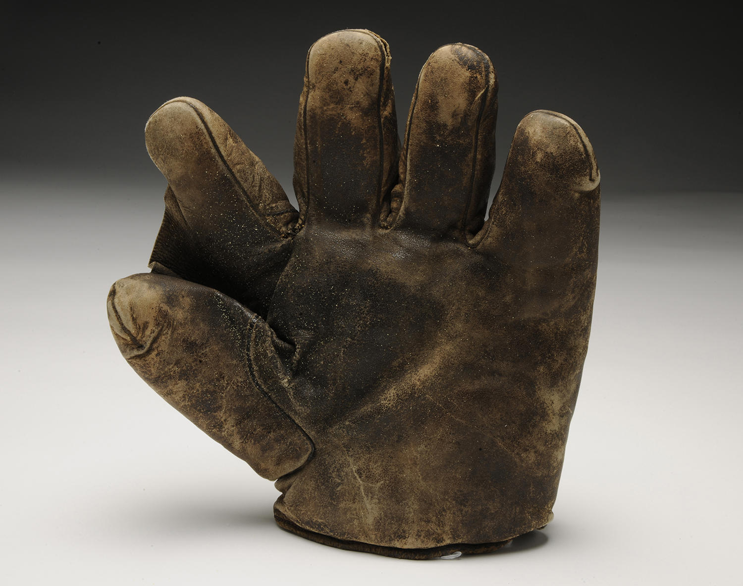 Hall of Fame center fielder Ty Cobb used this glove in 1912 when he was playing for the Detroit Tigers. (Milo Stewart Jr. / National Baseball Hall of Fame and Museum)