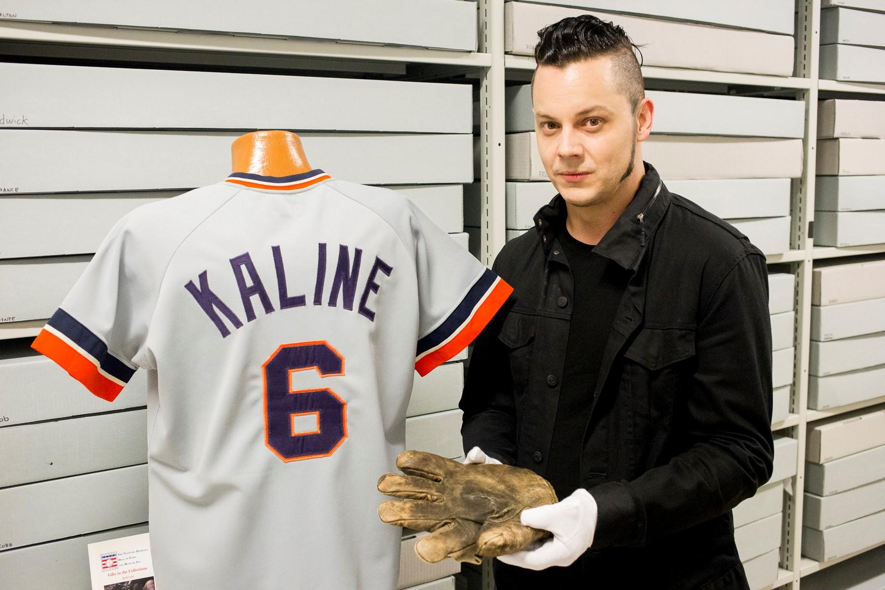 Tigers super-fan Jack White with Ty Cobb's glove and Al Kaline's jersey.