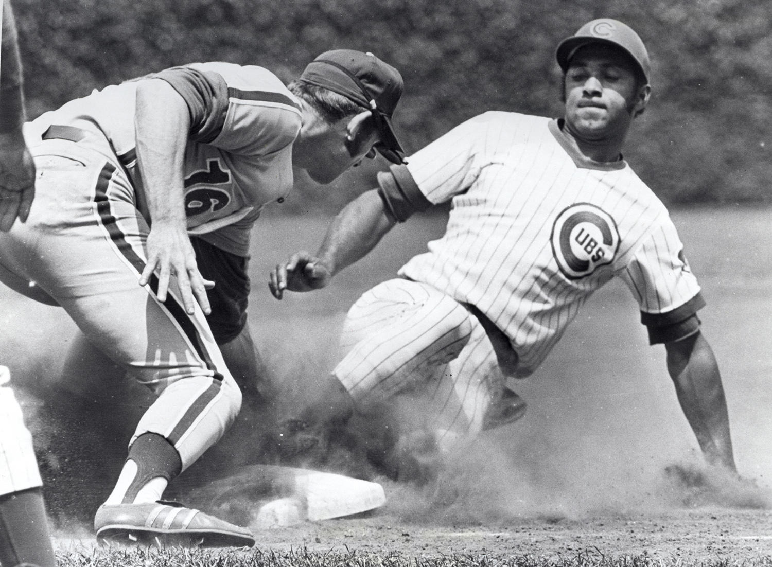 Billy Williams, pictured above sliding into third base, led the National League in total bases three times (1968, 1970 and 1972) and in extra base hits three times (1965, 1968 and 1972). (National Baseball Hall of Fame and Museum)