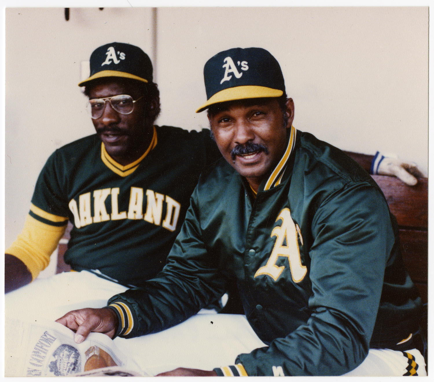 After playing for the Oakland Athletics for the final two years of his major league career, Billy Williams (right) returned to the team as a coach from 1983-1985. He's pictured above with A's designated hitter Mitchell Page. (Doug McWilliams / National Baseball Hall of Fame and Museum)