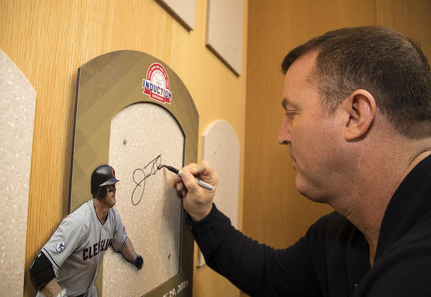 Hall of Famer Jim Thome signs his plaque backer during his Orientation Visit in Cooperstown on Feb. 27, 2018. (Milo Stewart Jr./National Baseball Hall of Fame and Museum)