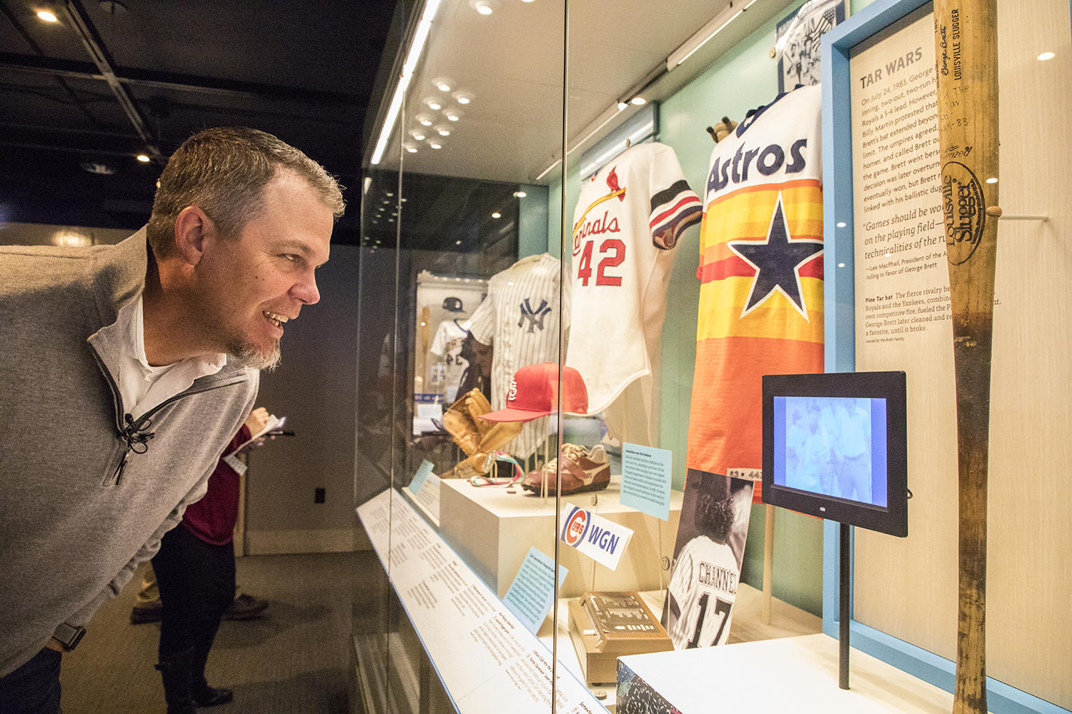 """Chipper Jones checks out of a video of George Brett's """"pine tar incident"""" during his Orientation Visit of the Hall of Fame. (Milo Stewart Jr./National Baseball Hall of Fame and Museum)"""
