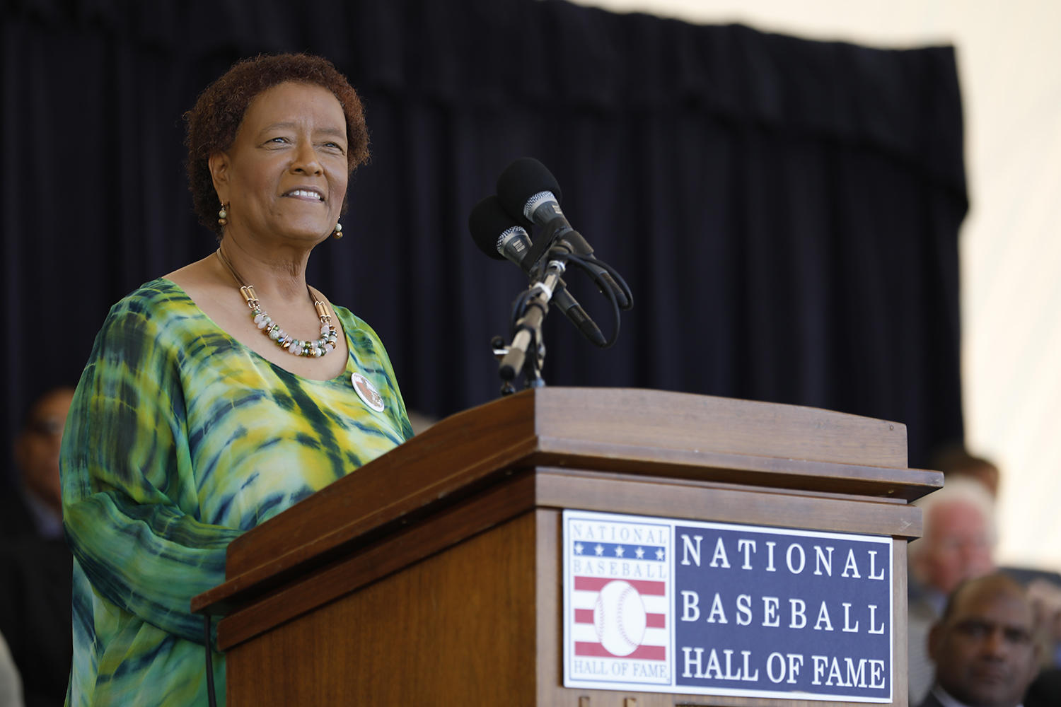 Claire Smith, pictured above, accepts the 2017 J.G. Taylor Spink Award at Saturday's <em>Awards Presentation</em>. (Milo Stewart Jr. / National Baseball Hall of Fame and Museum)