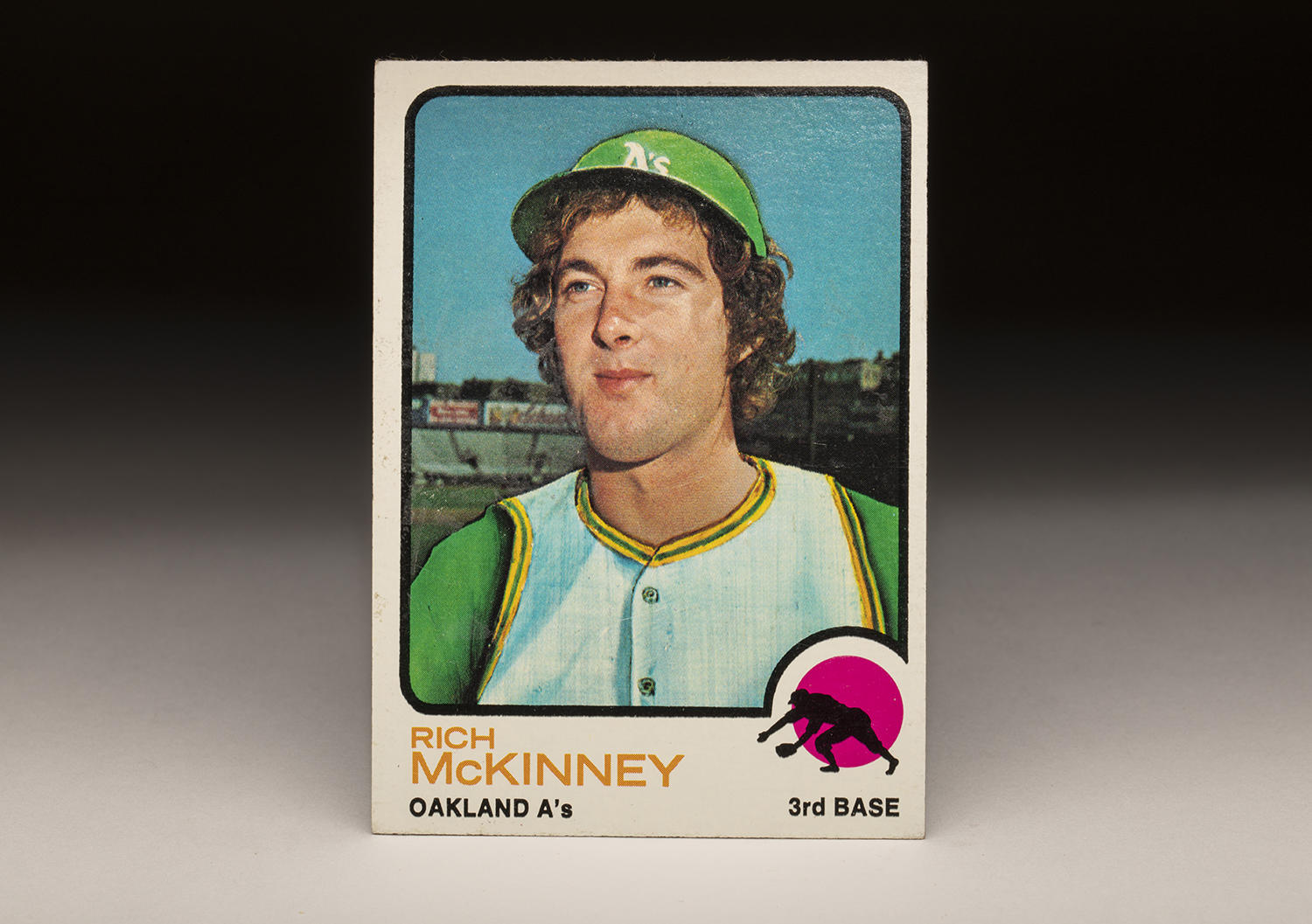In order to accommodate the fact that he had been traded from New York to Oakland during the winter, an artist at Topps airbrushed a green helmet onto Rich McKinney's head, and included green sleeves and gold piping on the jersey. (Milo Stewart Jr./National Baseball Hall of Fame and Museum)
