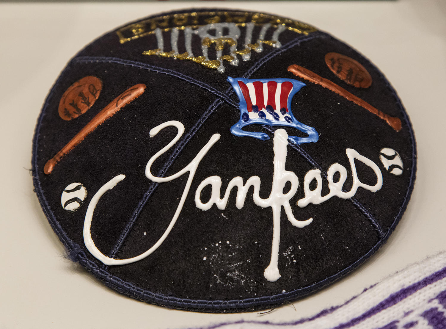 A Yankees-themed yarmulke, donated shortly after the New York Yankees won the World Series in 2000, is currently on display in the <em>Whole New Ballgame</em> exhibit. (Milo Stewart Jr. / National Baseball Hall of Fame)