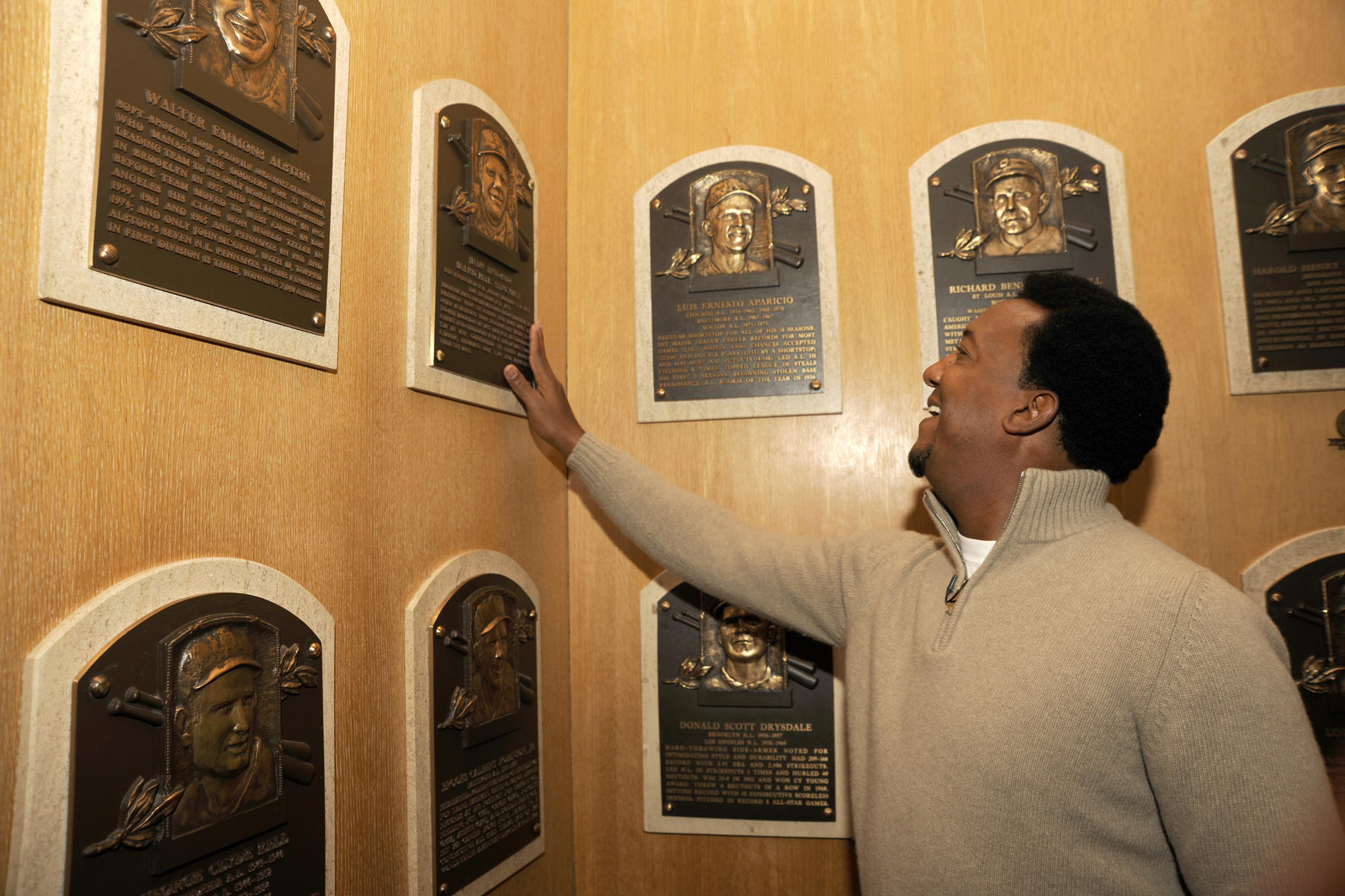 Pedro Martinez toured the Hall of Fame on Feb. 27 during his Orientation Visit, taking time to touch the Hall of Fame plaque of Dominican Republic countryman Juan Marichal. (Milo Stewart, Jr. / National Baseball Hall of Fame)