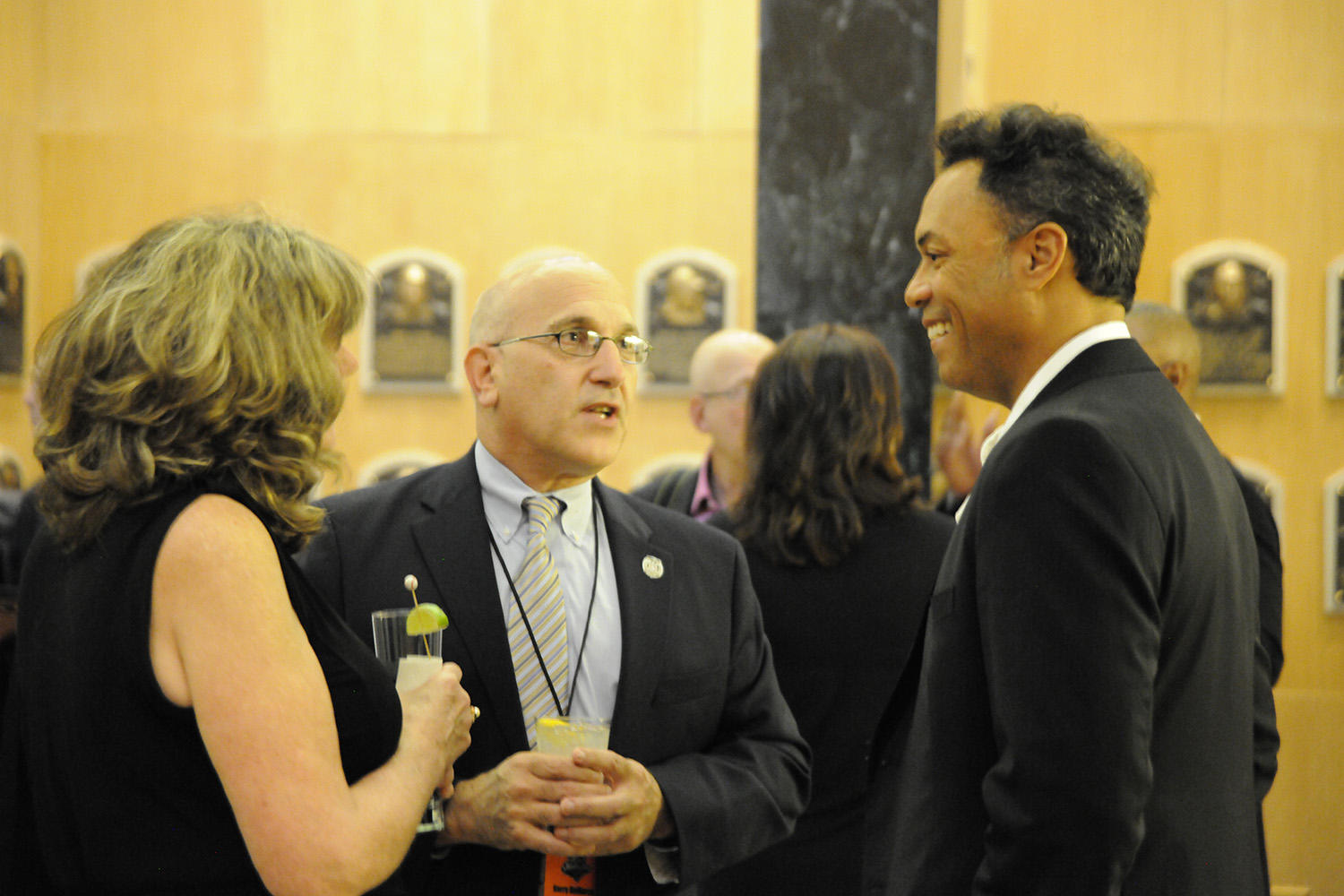 Kerry DeMarco and his girlfriend Colleen Kerr chat with Hall of Famer Roberto Alomar following the 2014 Cooperstown Golf Classic. (Milo Stewart Jr. / National Baseball Hall of Fame and Museum)