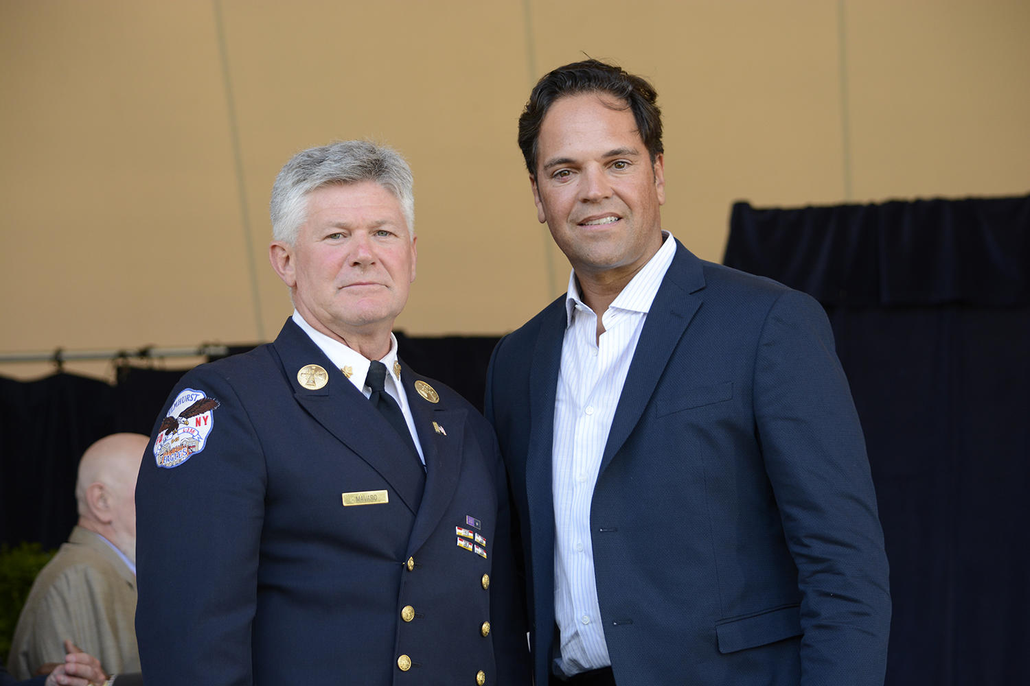 New York City Fire Department Battalion Chief Vin Mavaro stands beside 2016 Hall of Fame Inductee at that year's <em>Awards Presentation</em>. Mavaro shared his thoughts and memories of baseball's role in helping New York City, and the nation, recover from the 9/11 attacks.