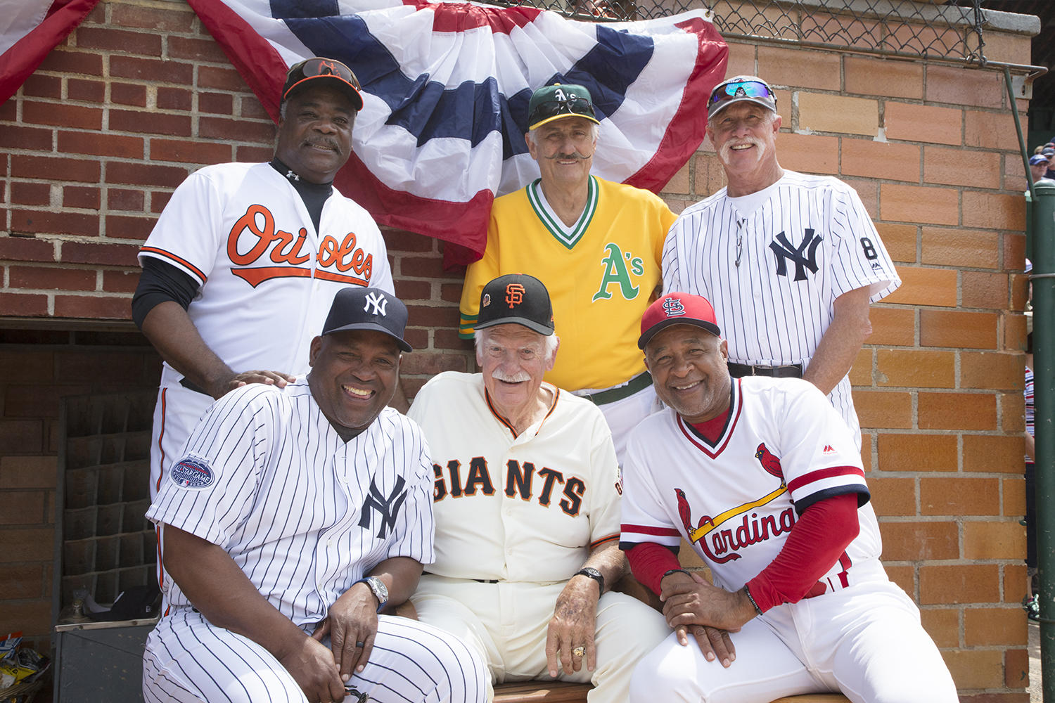 (Top row, left to right): Eddie Murray, Rollie Fingers and Goose Gossage pose with Tim Raines, Gaylord Perry and Ozzie Smith prior to the 2018 Hall of Fame Classic. (Milo Stewart Jr./National Baseball Hall of Fame and Museum)
