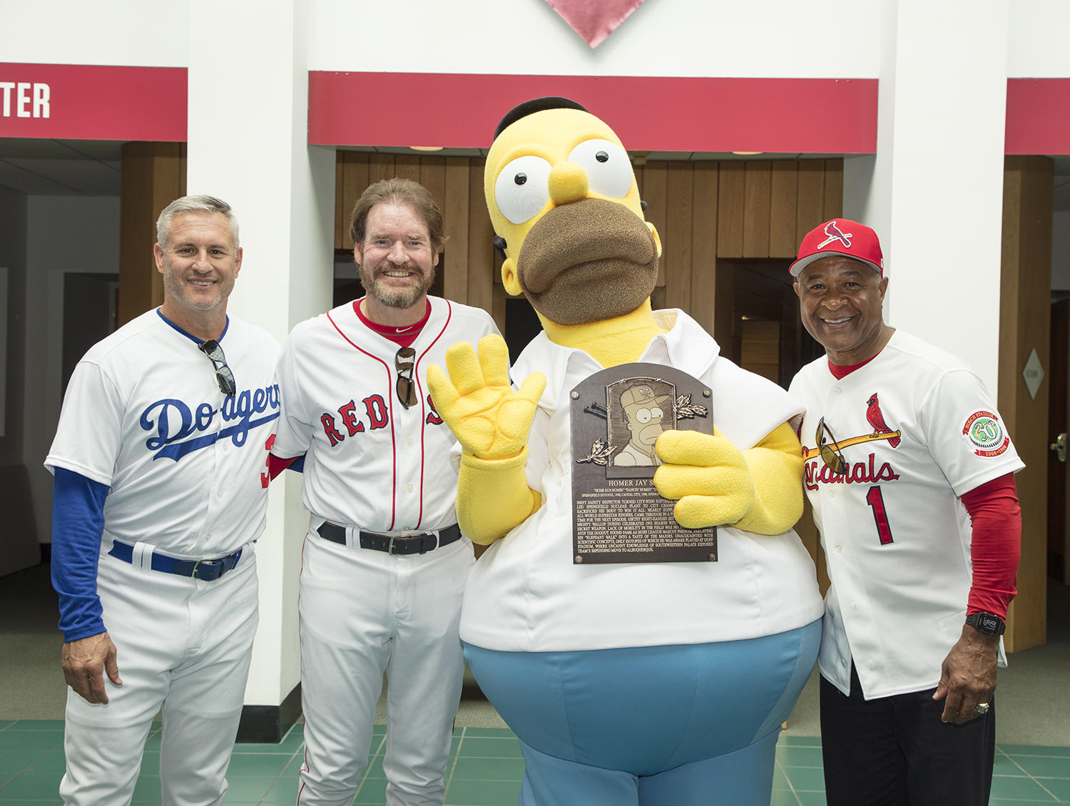 "Recently ""inducted"" Hall of Famer Homer Simpson poses with Steve Sax (left), Wade Boggs (left center) and Ozzie Smith (right) after the ""induction ceremony"" at the 2017 Hall of Fame Classic. (Milo Stewart Jr. / National Baseball Hall of Fame Classic)"