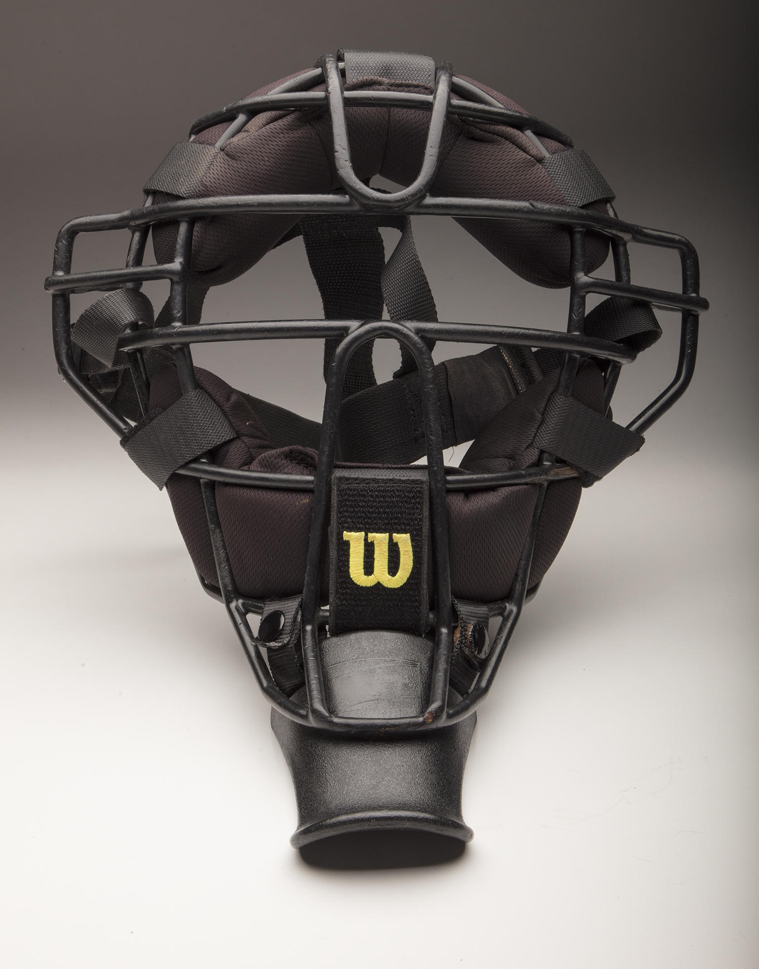 This catcher's mask, donated by female umpire Jen Pawol, was used throughout her professional baseball umpiring career. (By Photographer Milo Stewart Jr./National Baseball Hall of Fame and Museum)