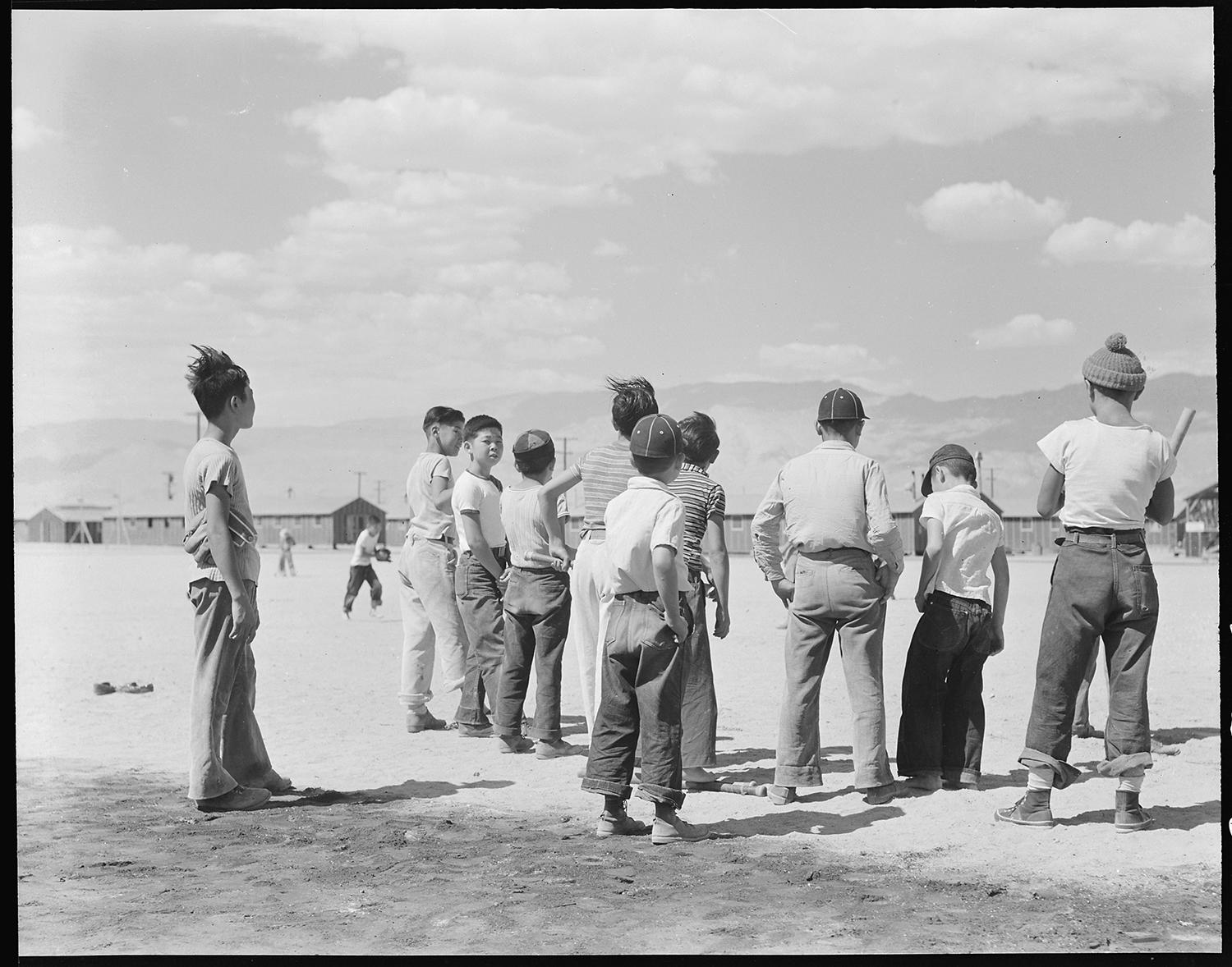 There were baseball fields at all 10 of the relocation centers during World War II, including Manzanar, pictured above. (Dorothea Lange / Courtesy of the National Archives and Records Administration)