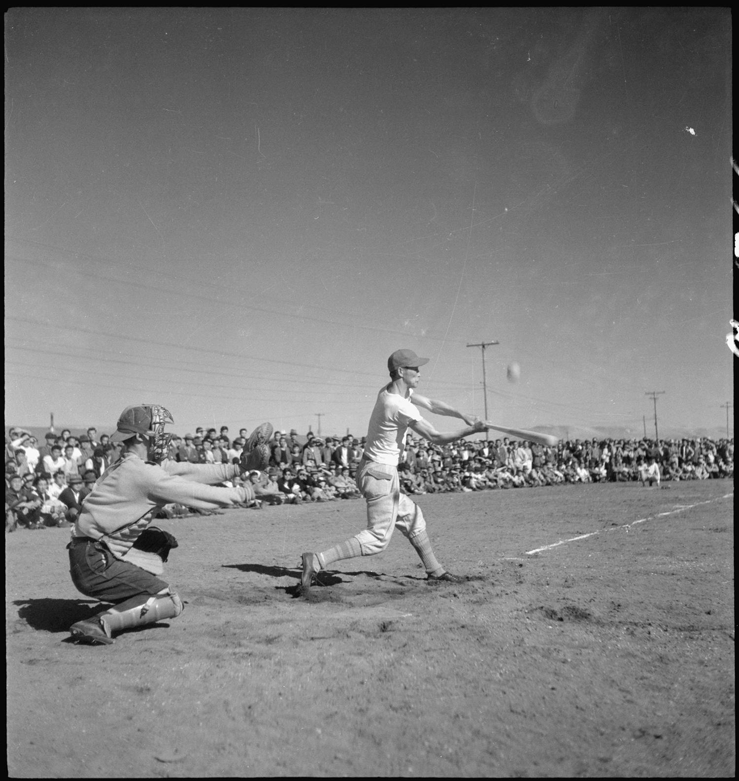 17,000 residents of the Tule Lake Relocation Center watch a baseball game in 1944. (Courtesy of the National Archives and Records Administration)