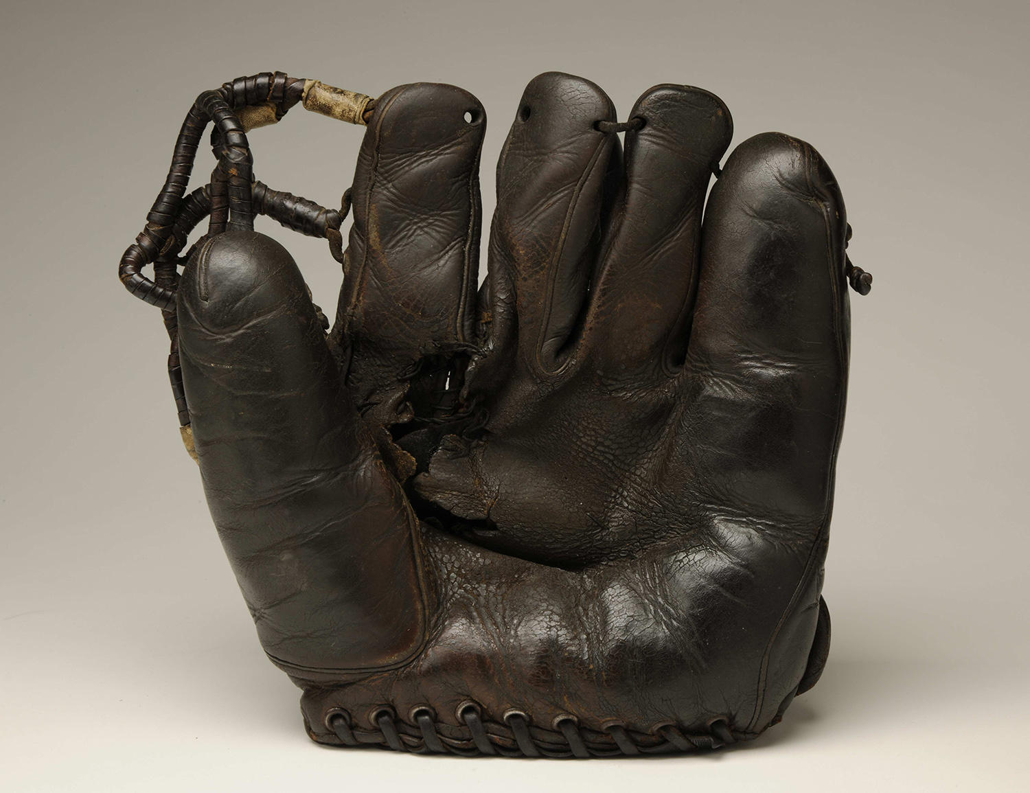 Joe DiMaggio used this glove during the 1938 and 1939 seasons, when he led the Yankees to back-to-back World Series wins. (Milo Stewart Jr. / National Baseball Hall of Fame and Museum)