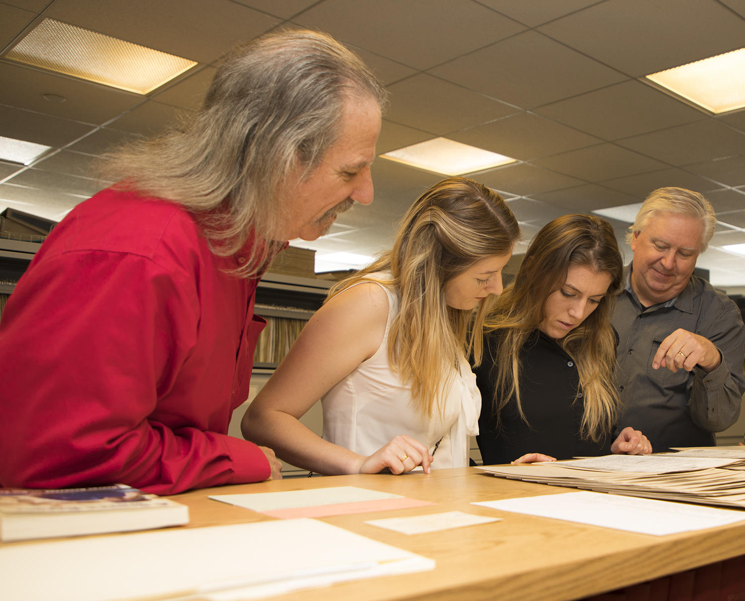 Former MLB player DeWayne Buice, Holly Haworth, Rose Haworth and Dan Taylor look at George Genovese's scouting reports, which were recently donated to the Hall of Fame. (Milo Stewart Jr./National Baseball Hall of Fame and Museum)