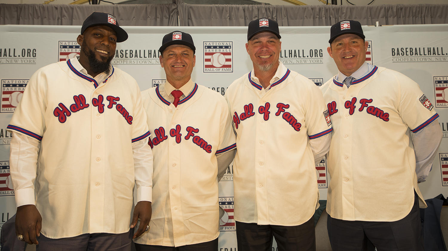 Vladimir Guerrero, Trevor Hoffman, Chipper Jones and Jim Thome pose for a photo after they meet the media for the first time as Hall of Famers. (Milo Stewart Jr./National Baseball Hall of Fame and Museum)