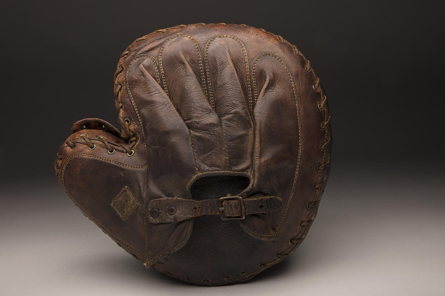 Gilbert Cooling, who played semi-professional baseball in the early 20th century, used this left-handed catcher's mitt during his career on the diamond. His son Charles donated it to the Hall of Fame in 1961. (Milo Stewart Jr. / National Baseball Hall of Fame and Museum)