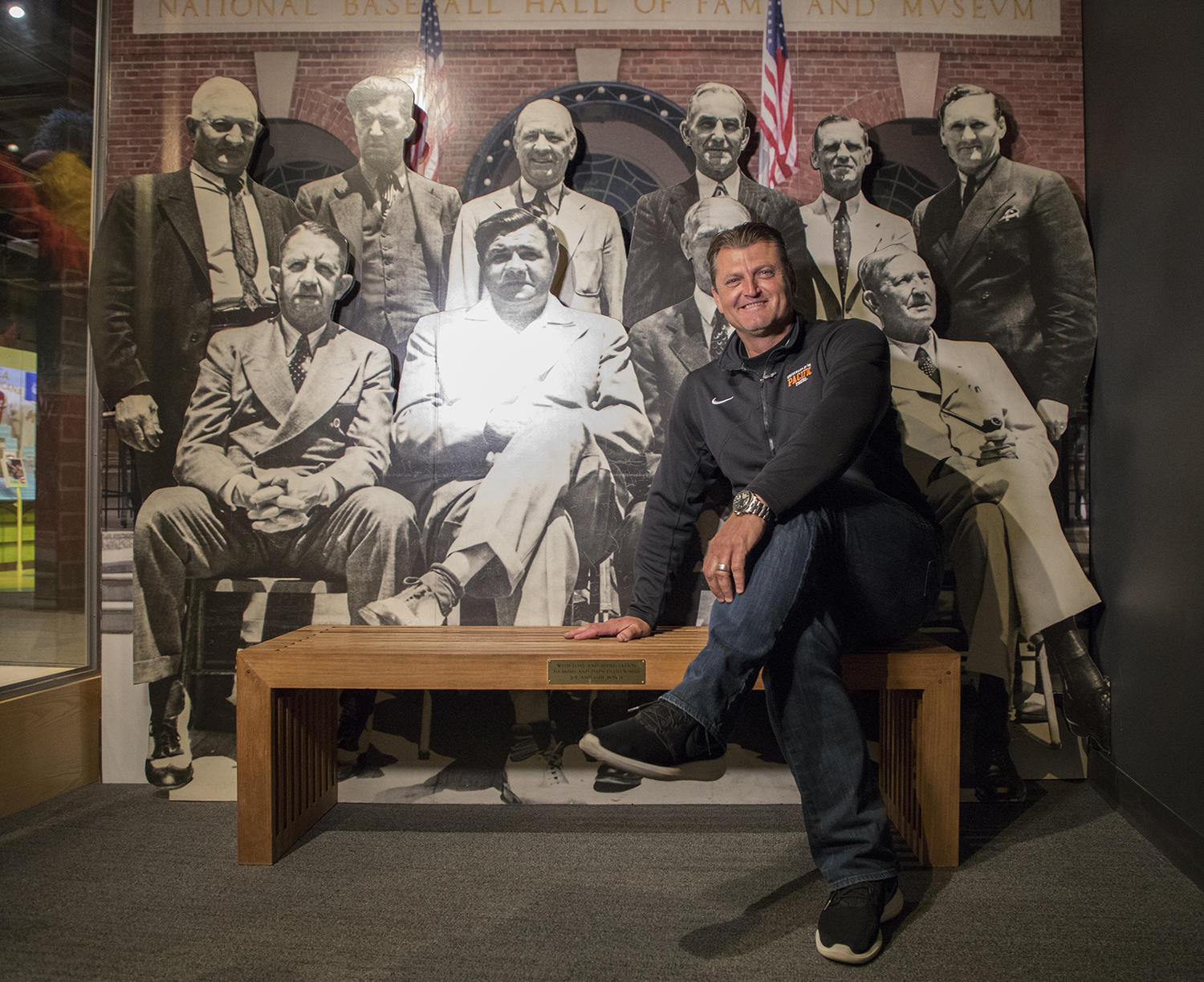 Trevor Hoffman sits in front of a photo taken of the first four classes of Hall of Famers on June 12, 1939, in Cooperstown. (Milo Stewart Jr./National Baseball Hall of Fame and Museum)