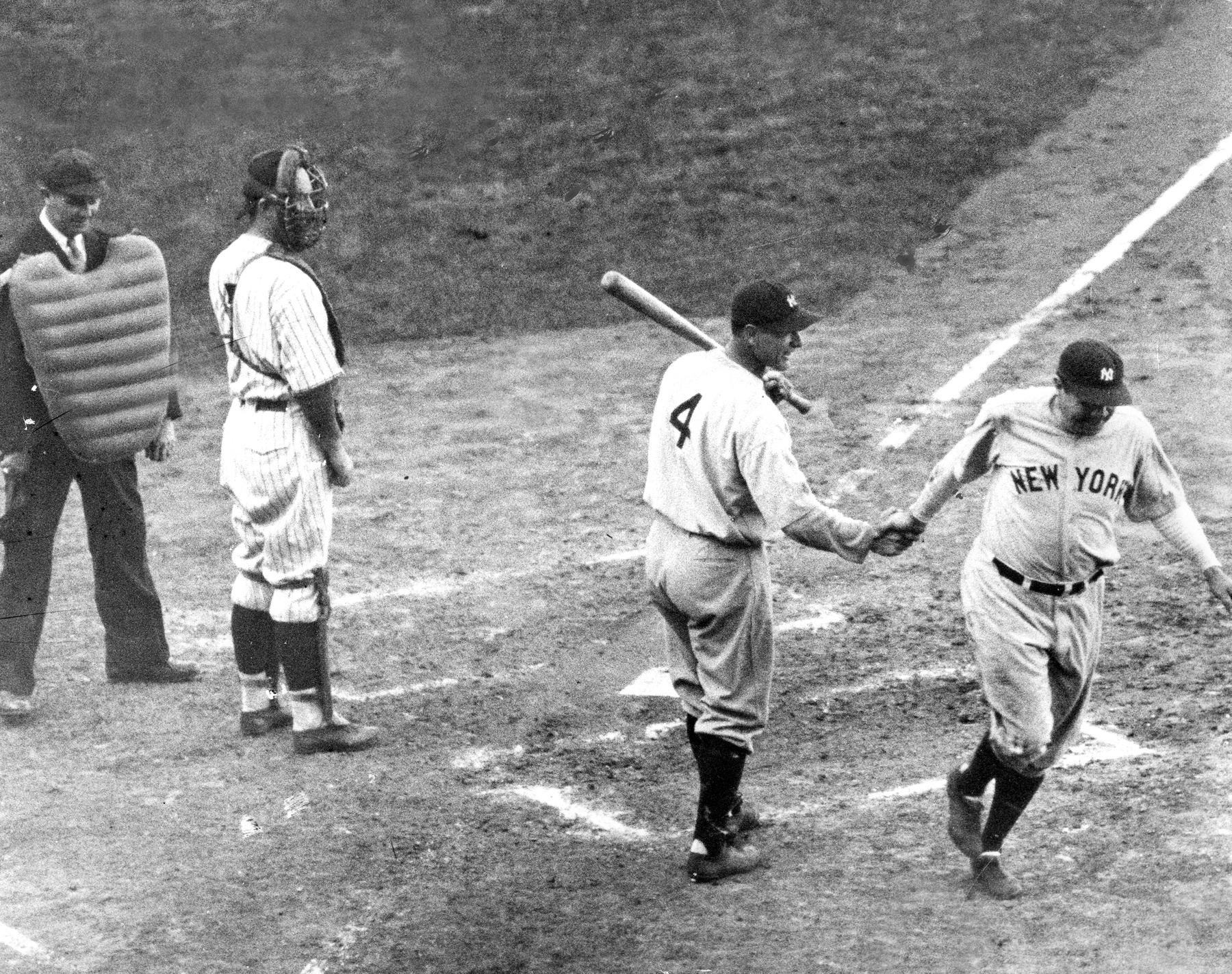 "Babe Ruth greeted by Lou Gehrig at home plate after hitting his ""Called Shot"" - BL-6499.76 (National Baseball Hall of Fame Library)"