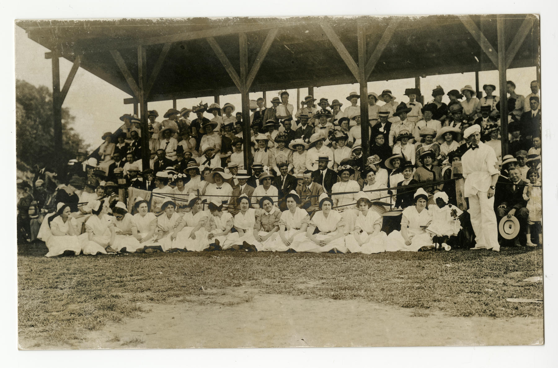 Spectators in the grandstand at the doctors vs dentists baseball game, a special fundraising event for Muhlenberg Hospital, at Parker Field (now the Hub Stine Sports Complex) in Plainfield, New Jersey, on June 14, 1913. - BL-49.2008.13 (Paul R. Collier / National Baseball Hall of Fame Library)