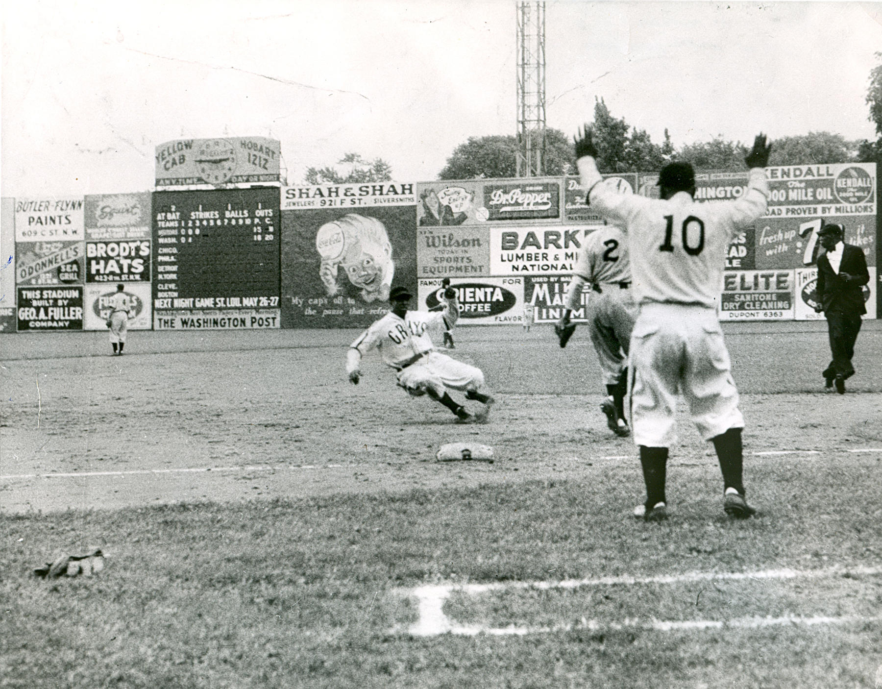 Cool Papa Bell of the Homestead Grays sliding into third base during the first game of a double-header against the Baltimore Elite Giants at Washington's Griffith Stadium on Negro National League Opening Day, May 16, 1943.