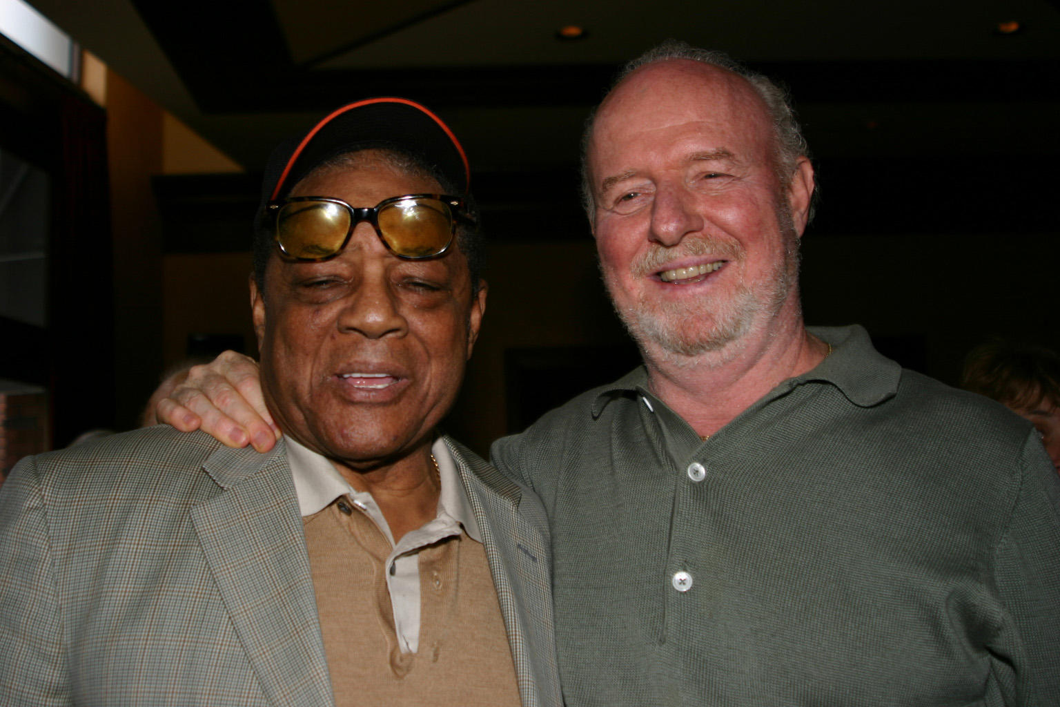 Terry Cashman with Willie Mays in San Francisco in 2004. Cashman was there to perform The Catch, to commemorate the 50th Anniversary of Willie's famous over-the-shoulder catch. BL-204.2011-2 (Laura Fieber-Minogue / National Baseball Hall of Fame Library)