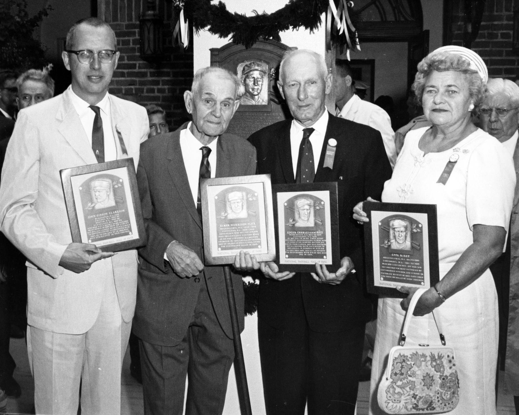 The Class of 1963 and deceased members' representatives hold their new plaques. From left to right:  Representative of John Clarkson, Elmer Flick, Sam Rice and Eppa Rixey's daughter. (National Baseball Hall of Fame Library)