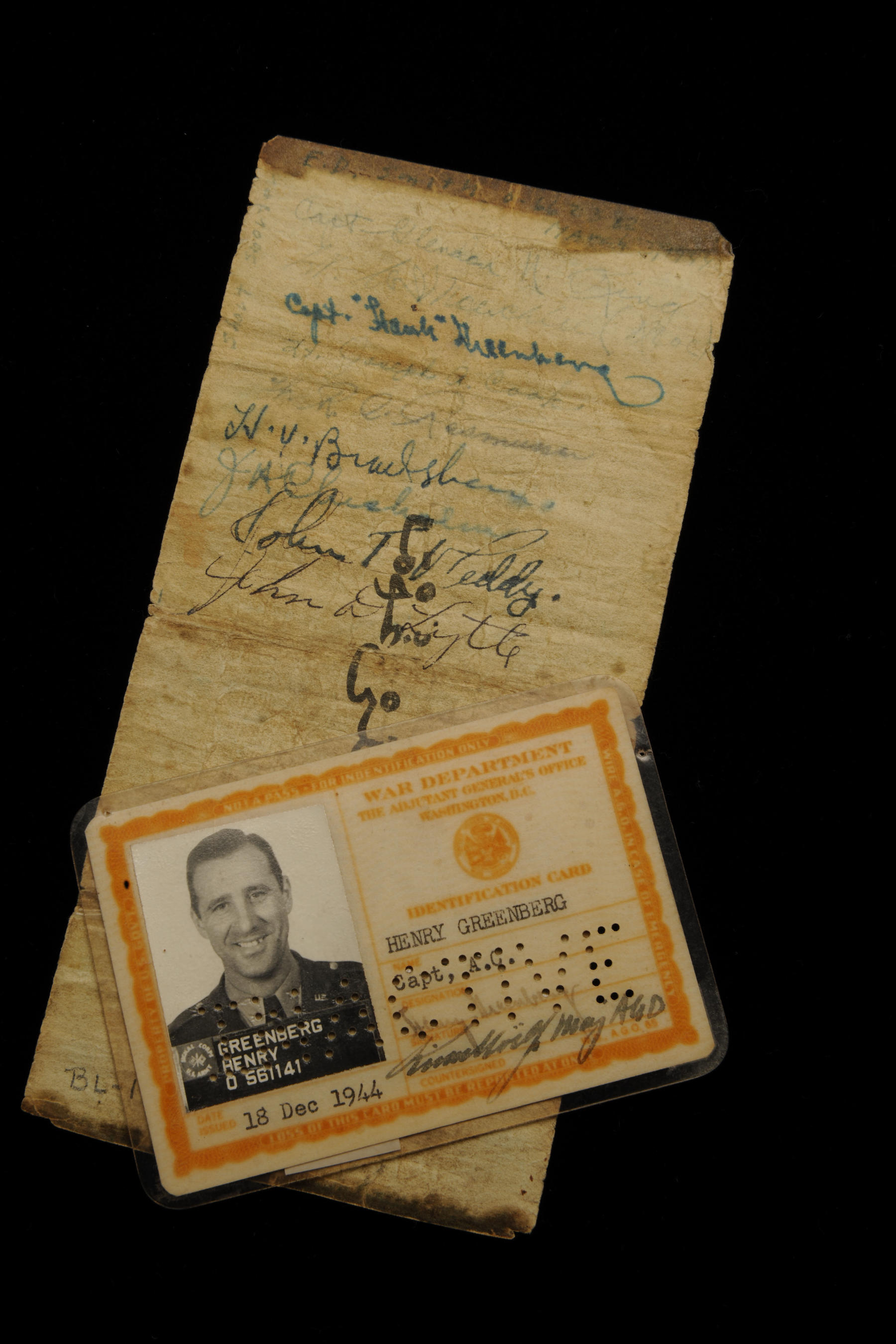 """The reverse side of the """"Short Snorter"""" pictured with Greenberg's military identification card.  The Hall of Famer's signature can be seen at the top of the bill in blue ink. BL-19.2009 and B-31.98 (Milo Stewart, Jr., National Baseball Hall of Fame Library)"""