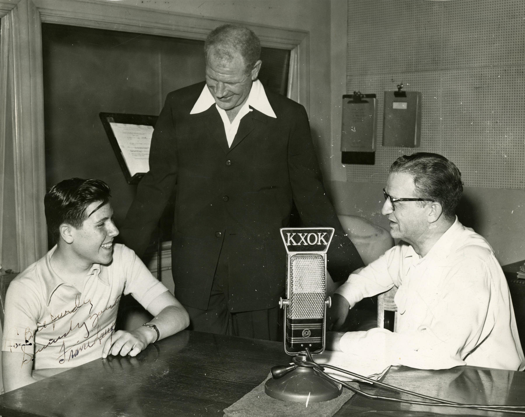 Bill Veeck with Bill Purdy, left, and France Laux, right, during a KXOX interview. Laux signed the photograph in the lower left corner. BL-363.2009.3 (KXOX Inc. / National Baseball Hall of Fame Library)