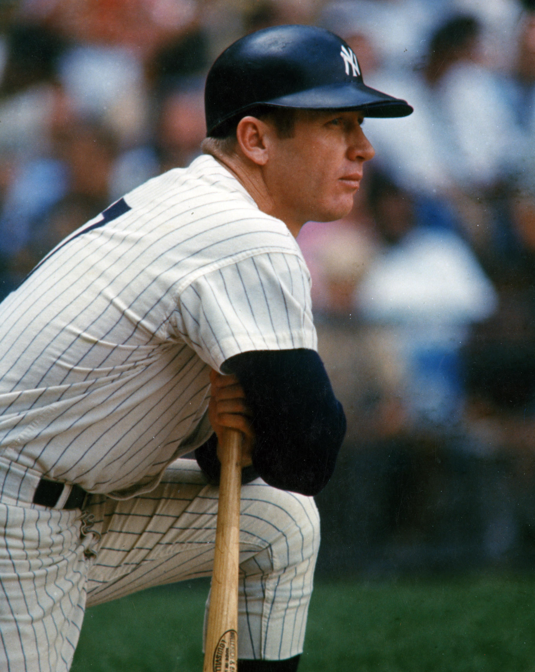Mickey Mantle kneeling, taking in the scene. BL-7274.89 (National Baseball Hall of Fame Library)