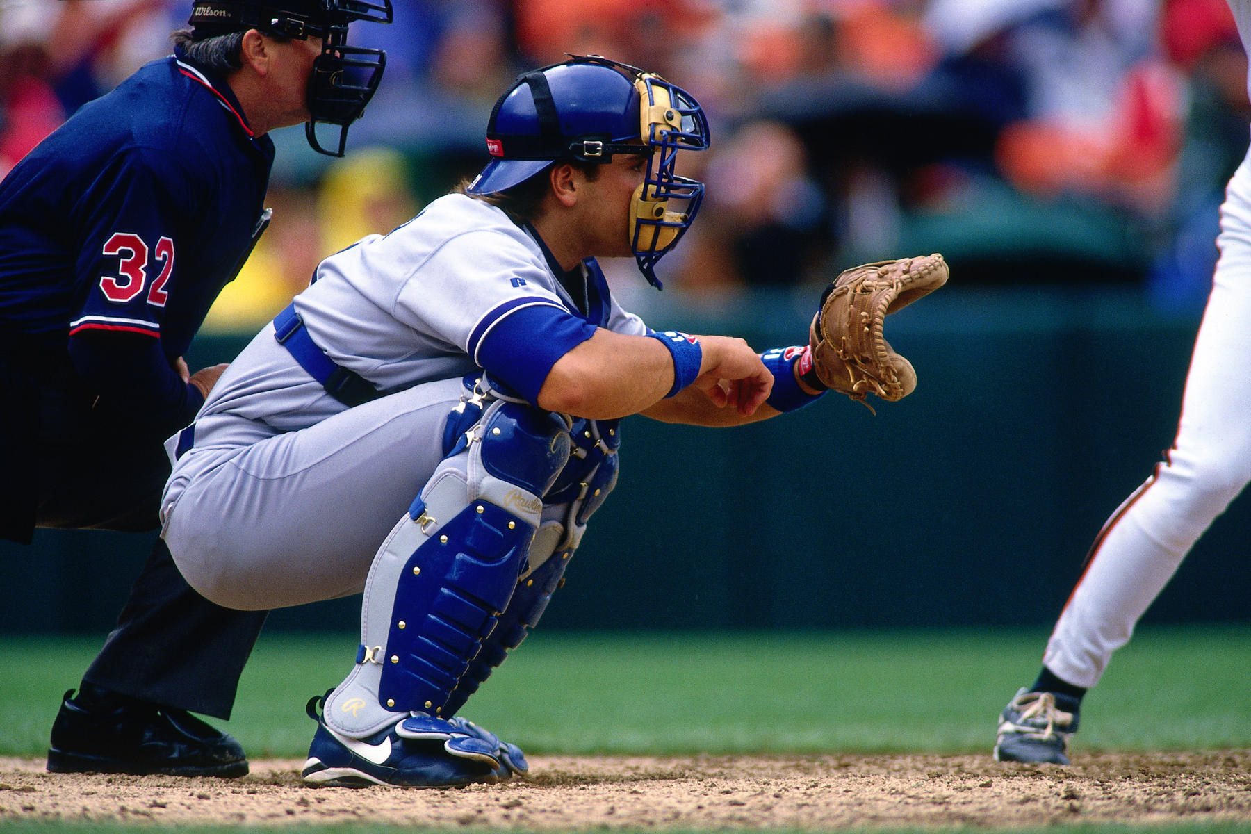 Mike Piazza of the Los Angeles Dodgers catching during a game against the San Francisco Giants in 1996. (Brad Mangin / National Baseball Hall of Fame Library)