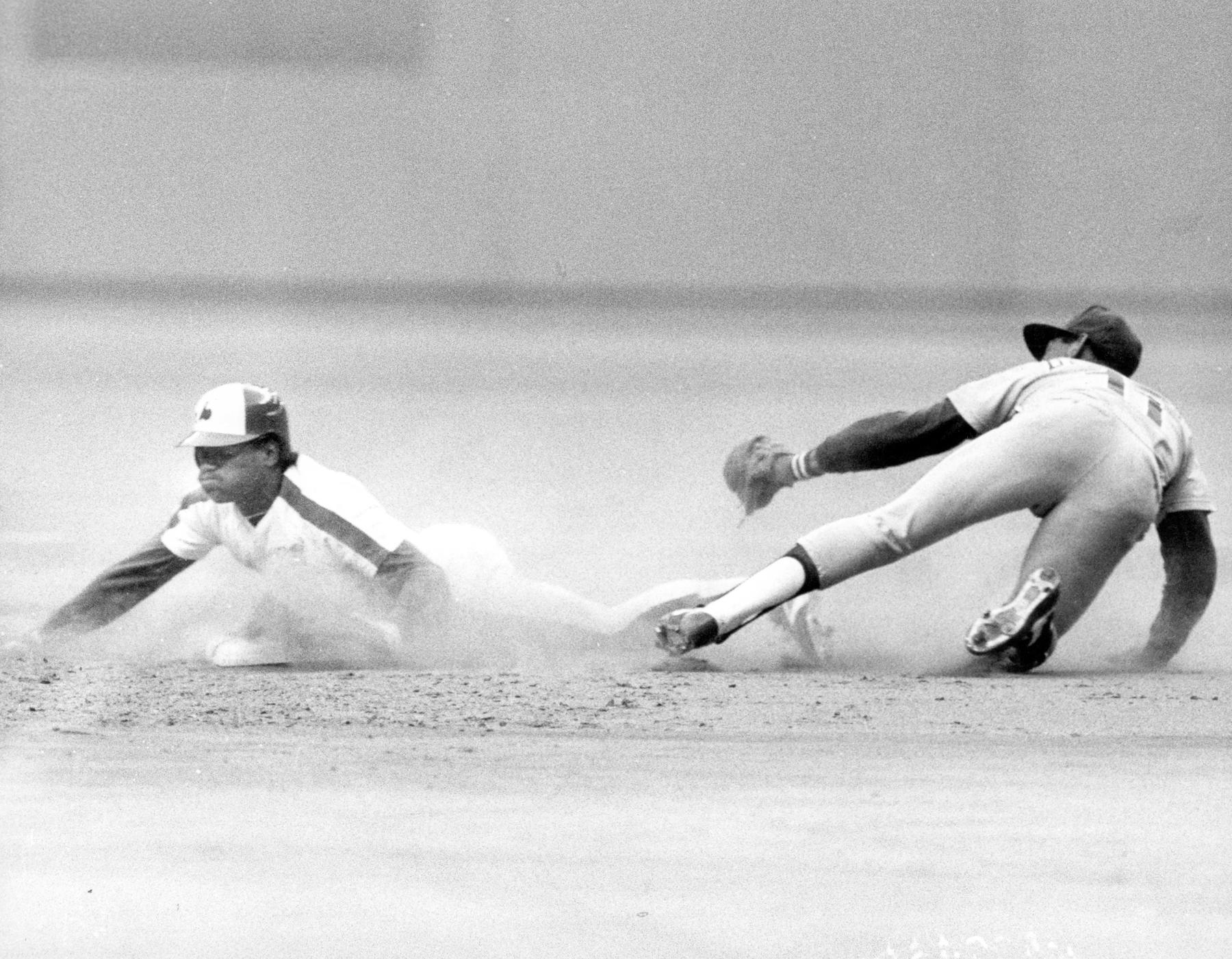 Tim Raines of the Montreal Expos sliding in safely after stealing a base. BL-1472.2002 (National Baseball Hall of Fame Library)