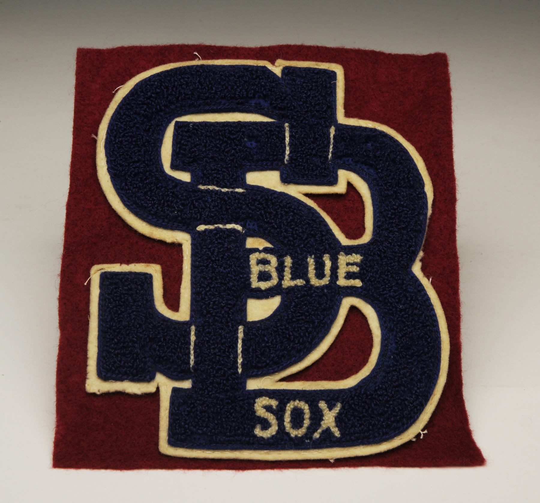 South Bend Blue Sox uniform patch worn by Dolly Brumfield-White of the All-American Girls' Professional Baseball League in 1947. - B-84.2003 (Milo Stewart, Jr. / National Baseball Hall of Fame)