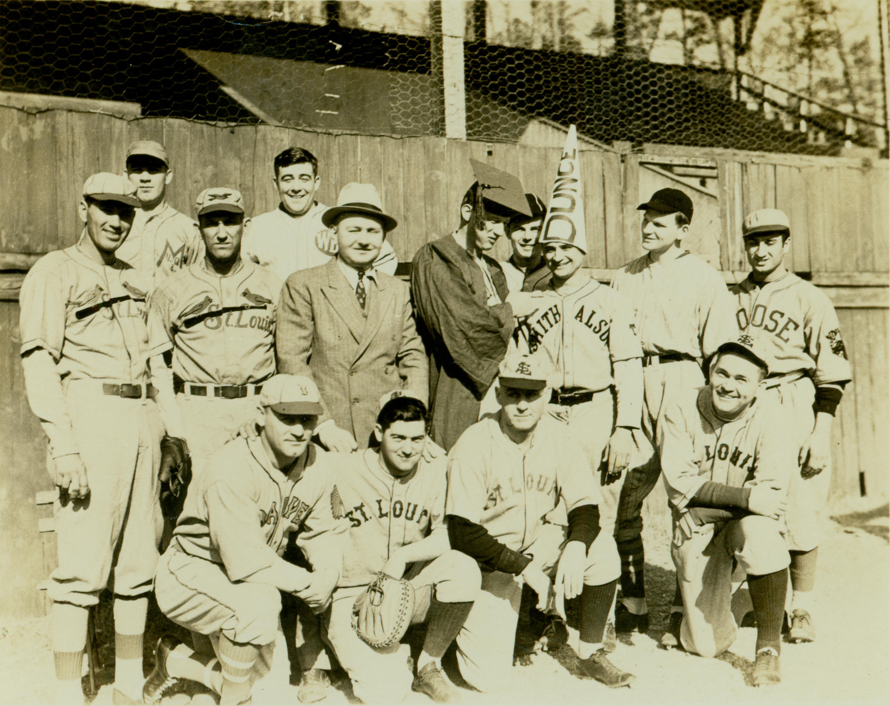 Instructors and students pose with Ray Doan (in suit and tie), who ran Ray Doan's Baseball School during the 1930s. - BL – 4716.73.42 (National Baseball Hall of Fame Library)