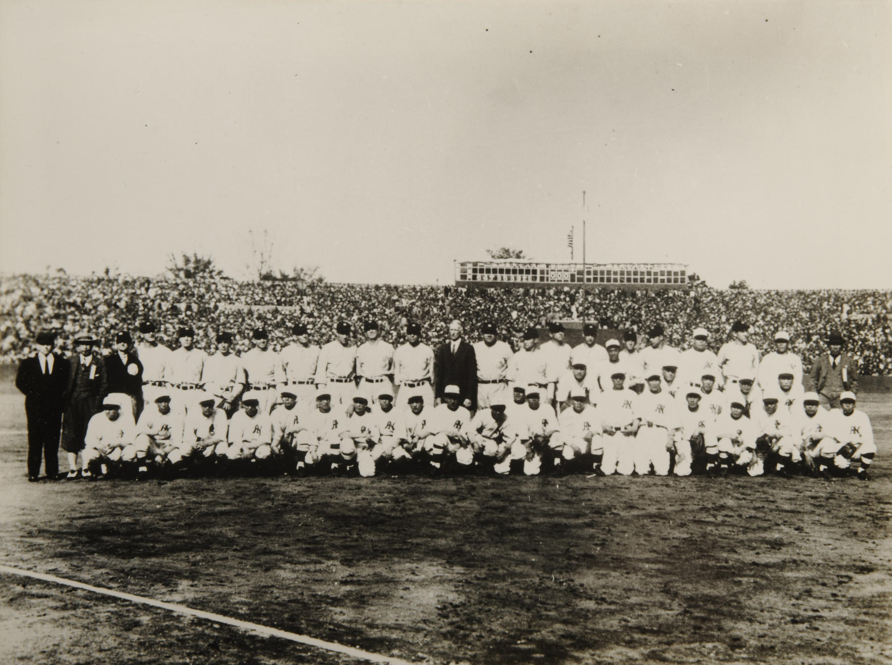 The All American and All Nippon teams pose on the field at Meiji Jingu Stadium in Tokyo before the first game of the tour. – B-277-51-21 (National Baseball Hall of Fame Library)