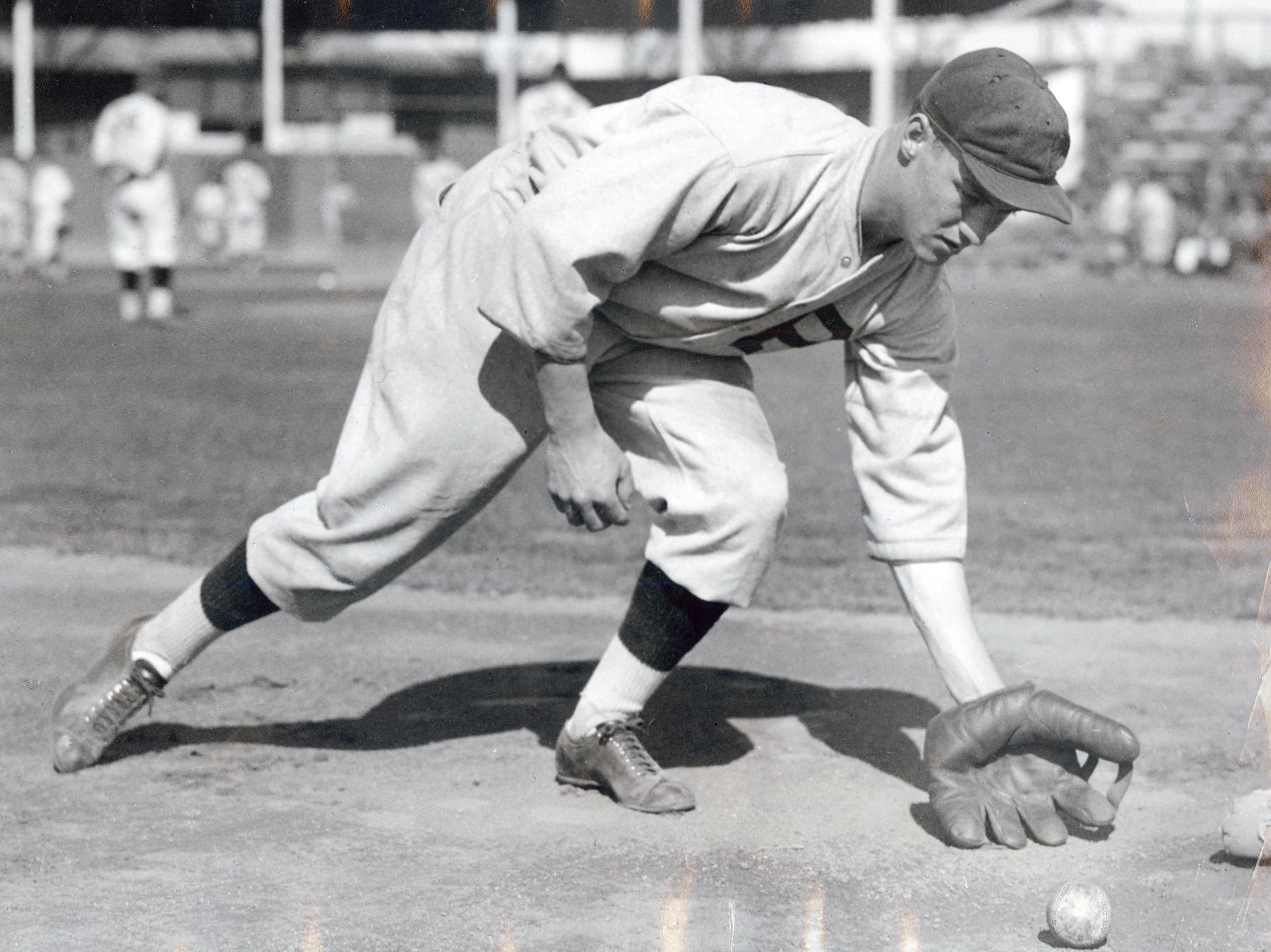 Arky Vaughan fielding a ground ball. BL-3787.68 (National Baseball Hall of Fame Library)