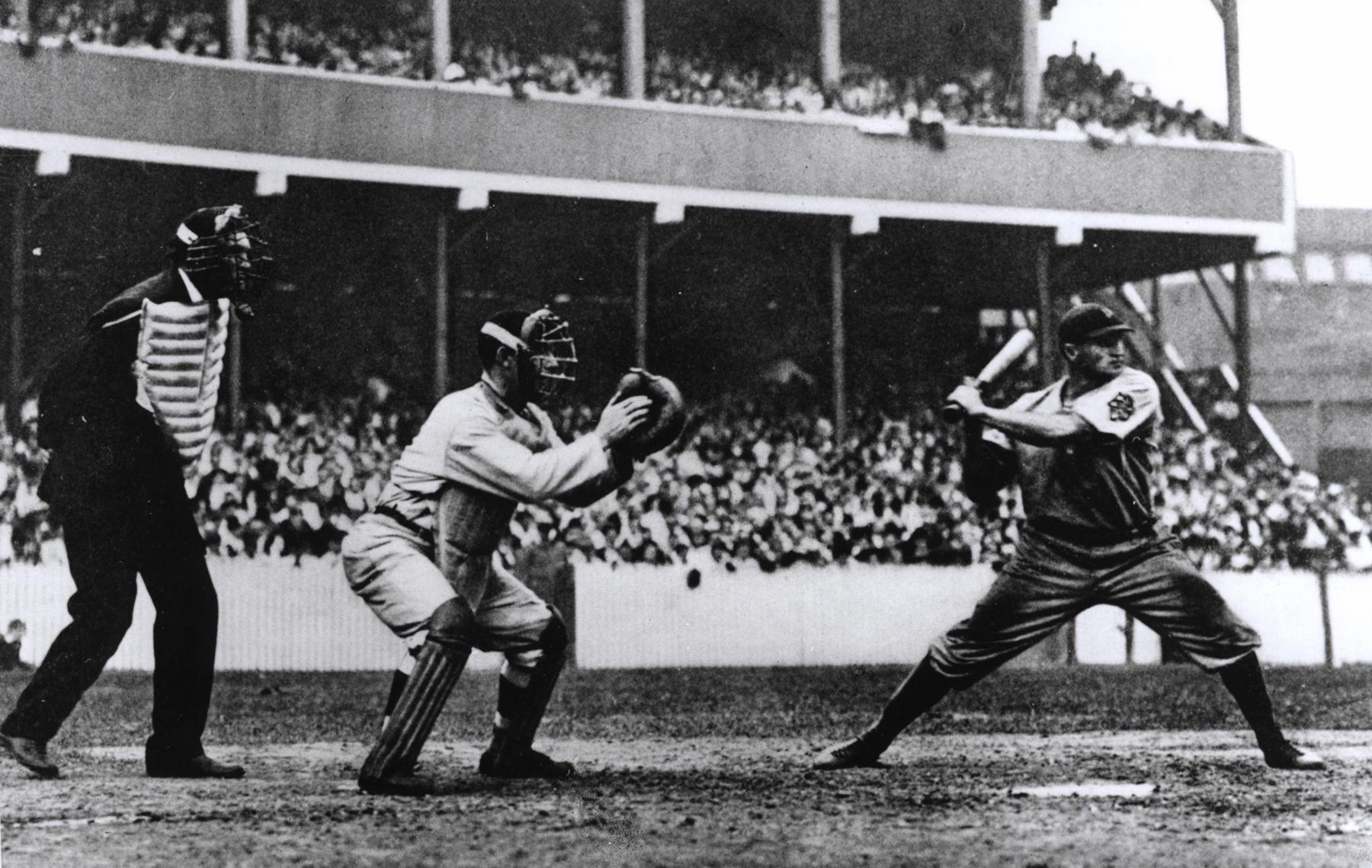 Umpire Hank O'Day, New York Giants catcher Roger Bresnahan and Pittsburgh Pirates batter Honus Wagner, New York's Polo Grounds, September 19, 1908 - BL-3993-99 (National Baseball Hall of Fame Library)