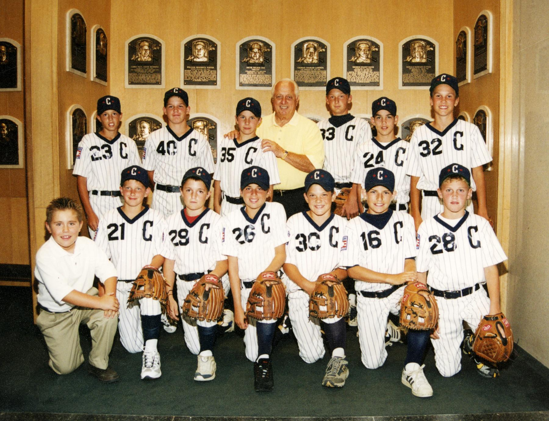 Phil Pohl (third from right, bottom) spent his youth in the shadows of baseball's hallowed ground. In this photo, Pohl's youth baseball team poses with Hall of Famer Tommy Lasorda in the Museum's Plaque Gallery. (Milo Stewart Jr. / National Baseball Hall of Fame)