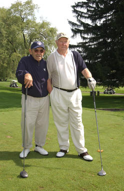 Red Schoendienst (right) poses with Yogi Berra for the annual Hall of Famer golf tournament in 2004. (Milo Stewart Jr./National Baseball Hall of Fame and Museum)