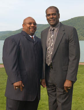 Bob Gibson (right) and Kirby Puckett share a moment on the shores of Otsego Lake in Cooperstown during Hall of Fame Weekend 2004. (Milo Stewart Jr./National Baseball Hall of Fame and Museum)