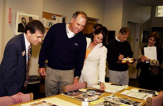 Ryne Sandberg looks at photos taken during his 16-year long career while on his Hall of Fame Orientation Visit. (Milo Stewart Jr. / National Baseball Hall of Fame)